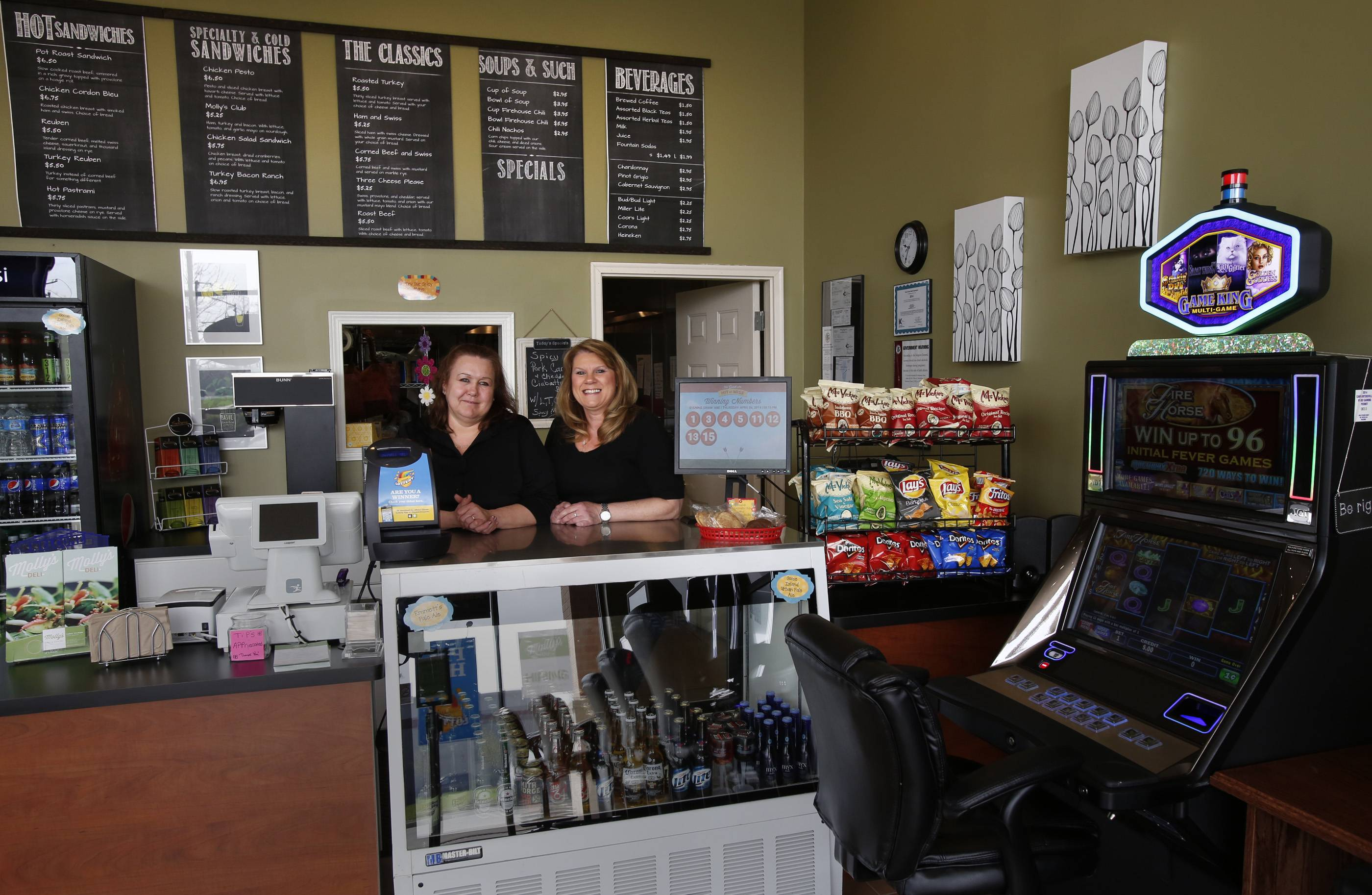 Manager Terry Tylman, right, and assistant manager Roberta Pittenturf are ready to take your order at Molly's Deli in Carpentersville, where customers can enjoy video gaming along with deli sandwiches and drinks.