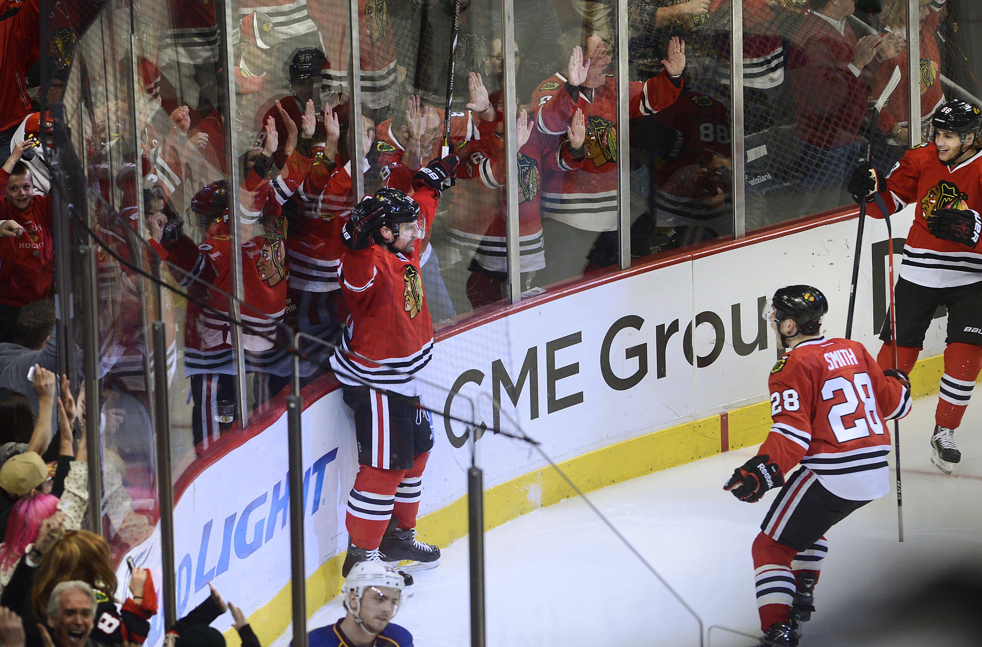 Blackhawks left wing Patrick Sharp celebrates his third-period goal with fans Sunday in Game 6 of the NHL first round playoffs at the United Center in Chicago. Chicago beat the St. Louis Blues to advance to the second round of the playoffs.