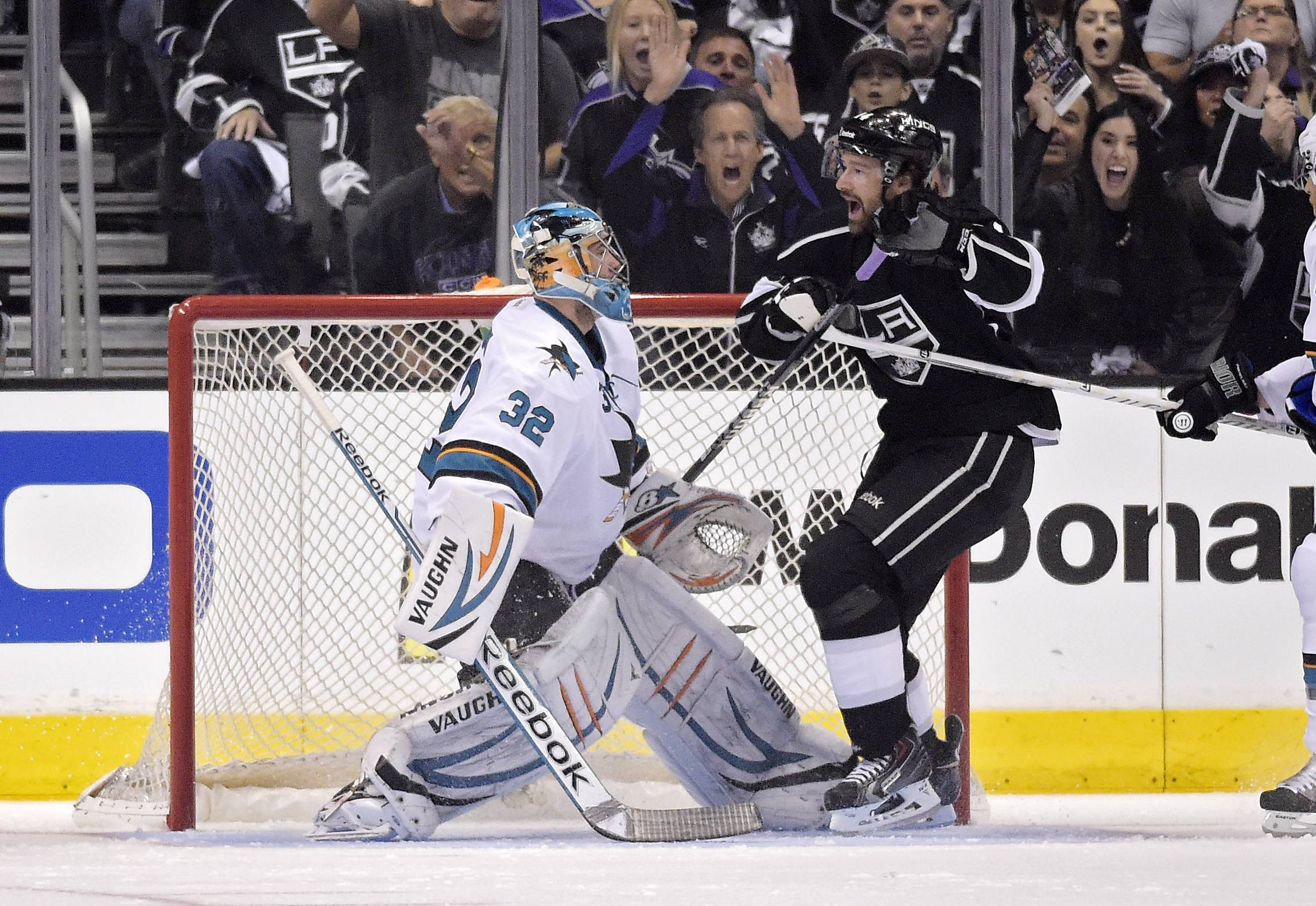 Los Angeles Kings right wing Justin Williams, right, celebrates his goal against San Jose Sharks goalie Alex Stalock during the first period in Game 6 of their NHL hockey first-round playoff series, Monday.