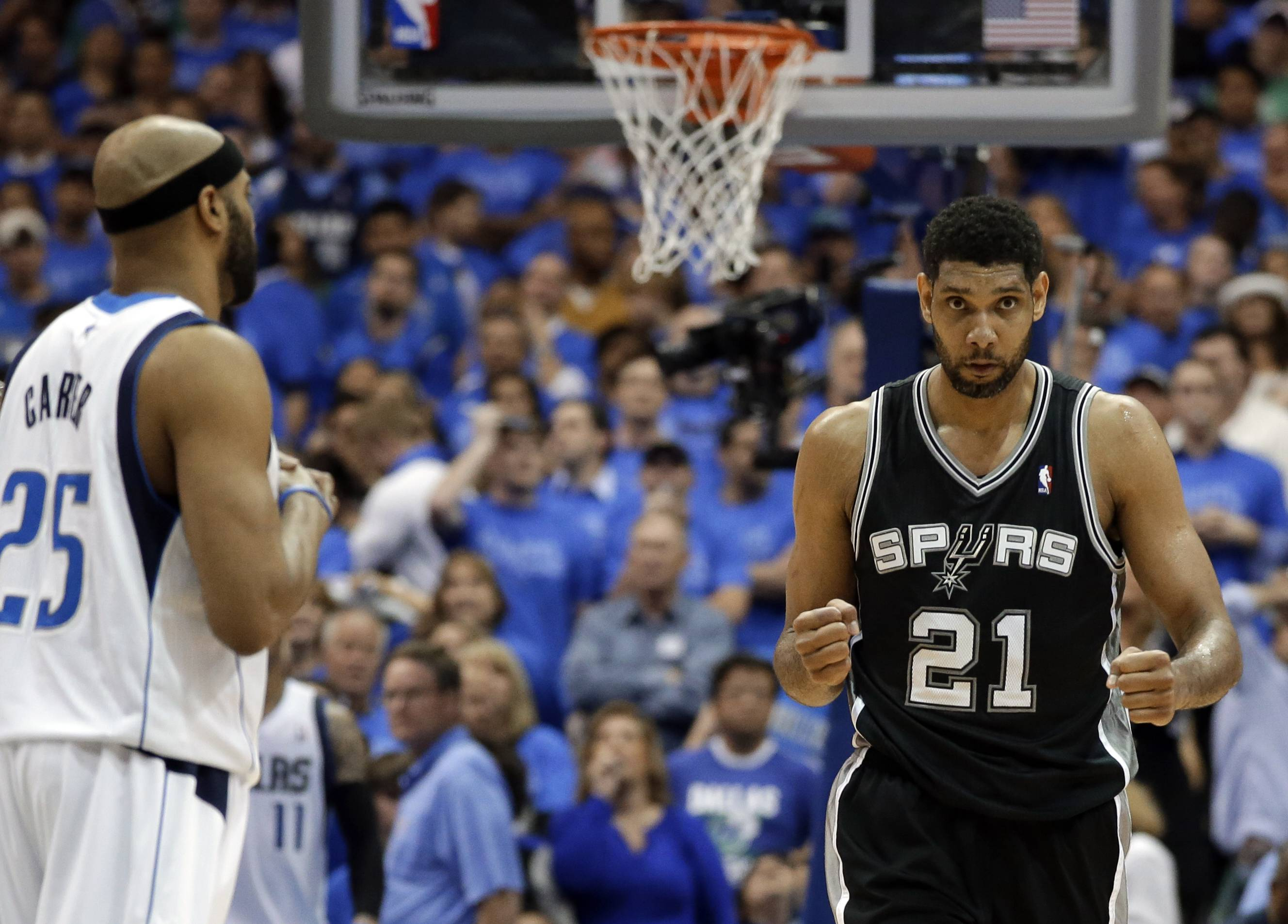 Dallas Mavericks' Vince Carter (25) watches as San Antonio Spurs' Tim Duncan (21) celebrates in the final seconds of Game 4 of their NBA basketball first-round playoff series, Monday.