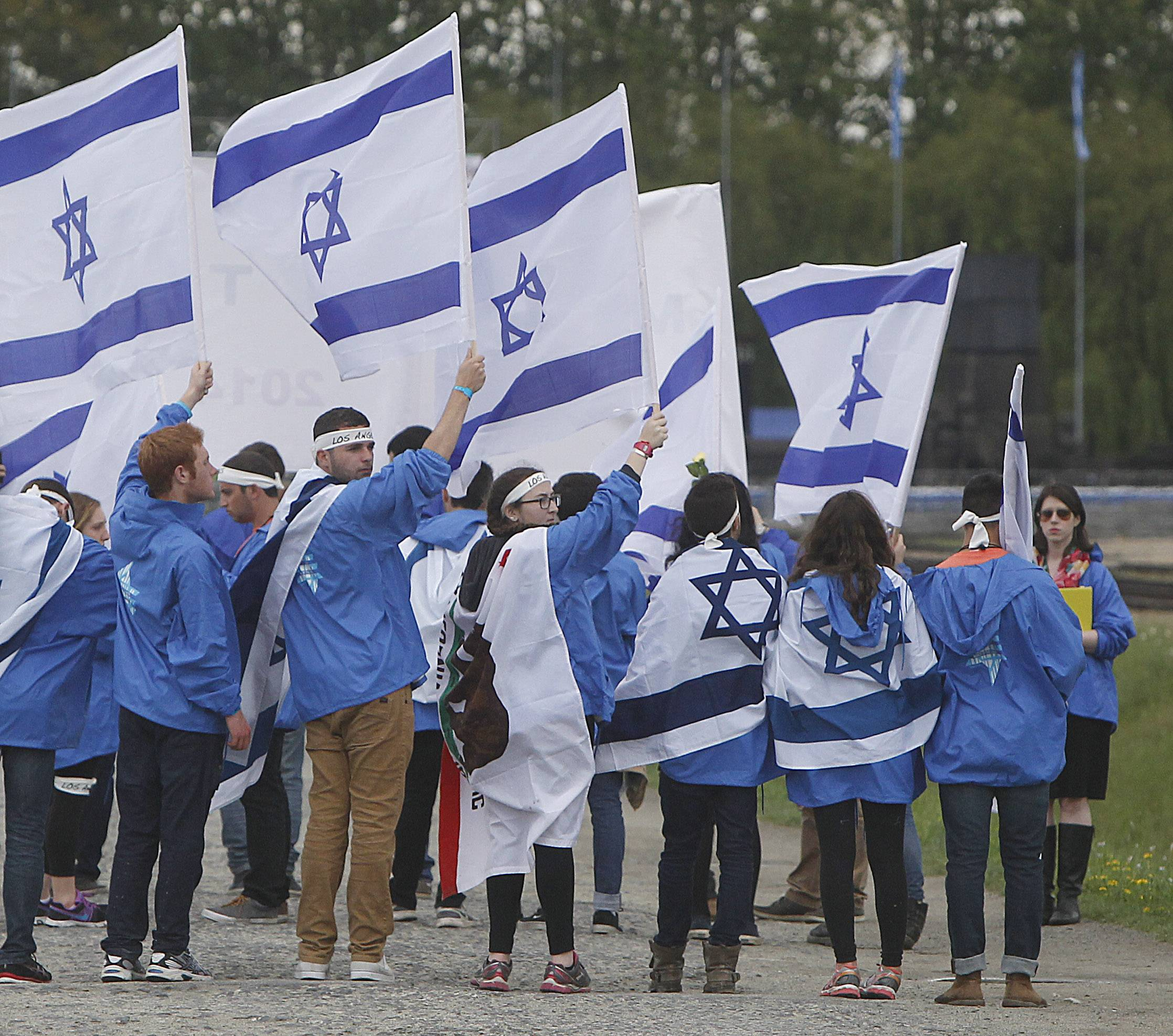 Young Jews from Israel and other countries march in silence between the two parts of Auschwitz-Birkenau, the Nazi German death camp, in an annual march of the living in Oswiecim, Poland, Monday. This year, the march honors some 430,000 Hungarian Jews killed in Birkenau gas chambers in 1944.
