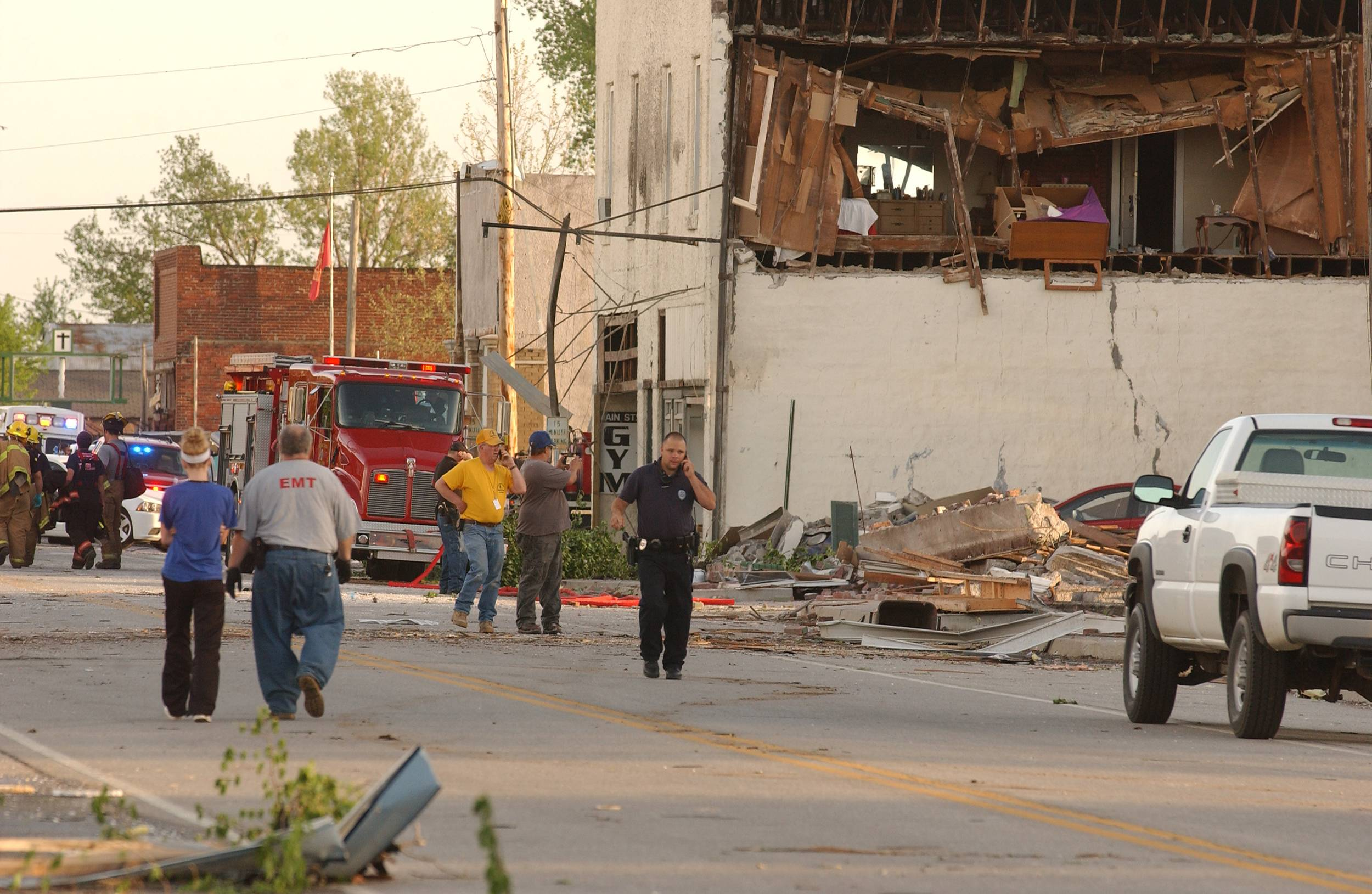 First responders, volunteers and firemen gather on Main Street in Quapaw, Okla. after a tornado struck the city on Sunday evening, April 27, 2014.    A powerful storm system rumbled through the central and southern United States on Sunday, spawning a massive tornado that carved path of destruction through the northern Little Rock suburbs and another twister that killed two people in Oklahoma and injured others in Kansas