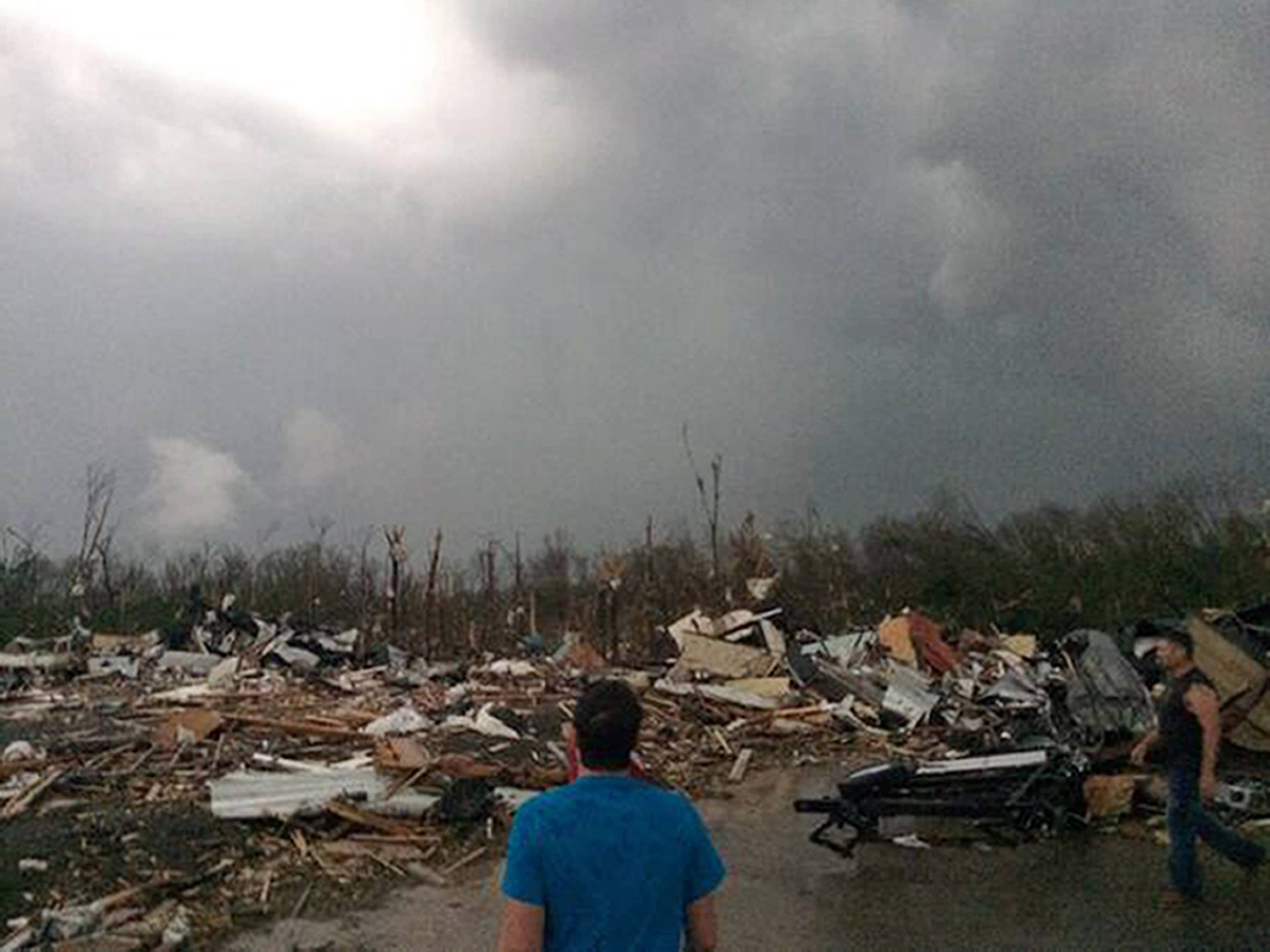This photo provided by James Bryant shows tornado damage, Sunday, April 27, 2014 in Mayflower, Ark. A powerful storm system rumbled through the central and southern United States on Sunday, spawning several tornadoes, including one that killed two people in a small northeastern Oklahoma City and another that carved a path of destruction through several northern suburbs of Little Rock, Ark.