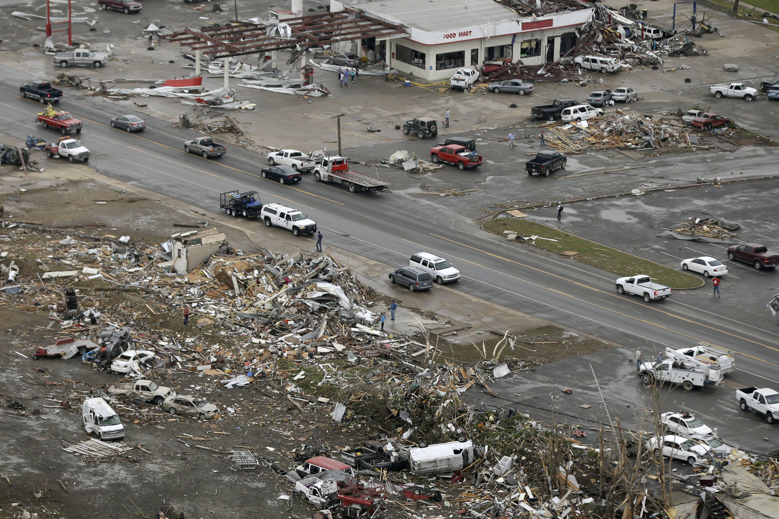 Homes and businesses are wrecked in downtown Vilonia, Ark., Monday, April 28, 2014 after a tornado struck the town late Sunday. The most powerful twister this year carved an 80-mile path of destruction through suburbs north of the state capital of Little Rock, killing at least 16 people.