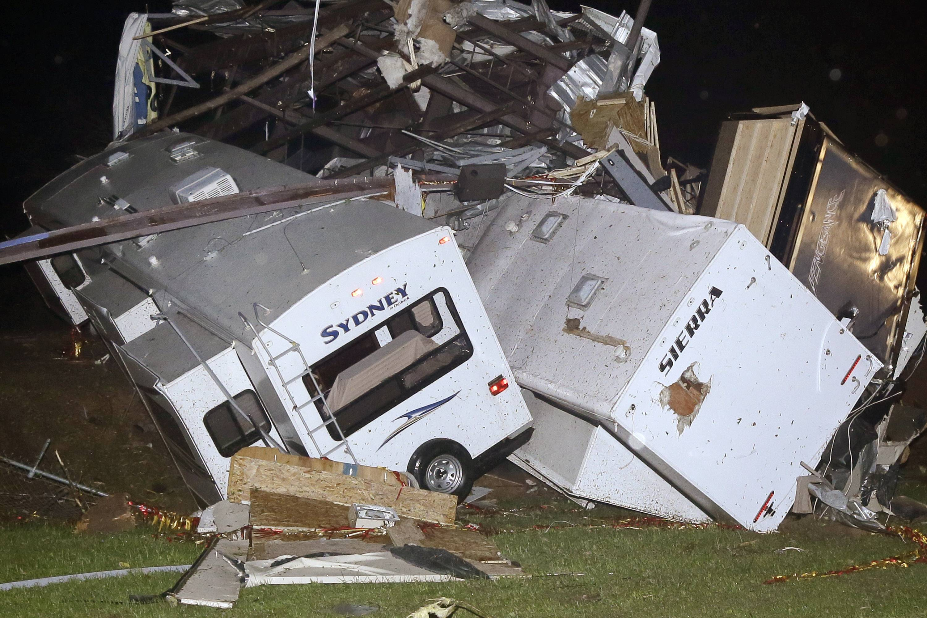 Travel trailers and motor homes are piled on top of each other at Mayflower RV in Mayflower, Ark., Sunday, April 27, 2014. A powerful storm system rumbled through the central and southern United States on Sunday, spawning tornadoes.