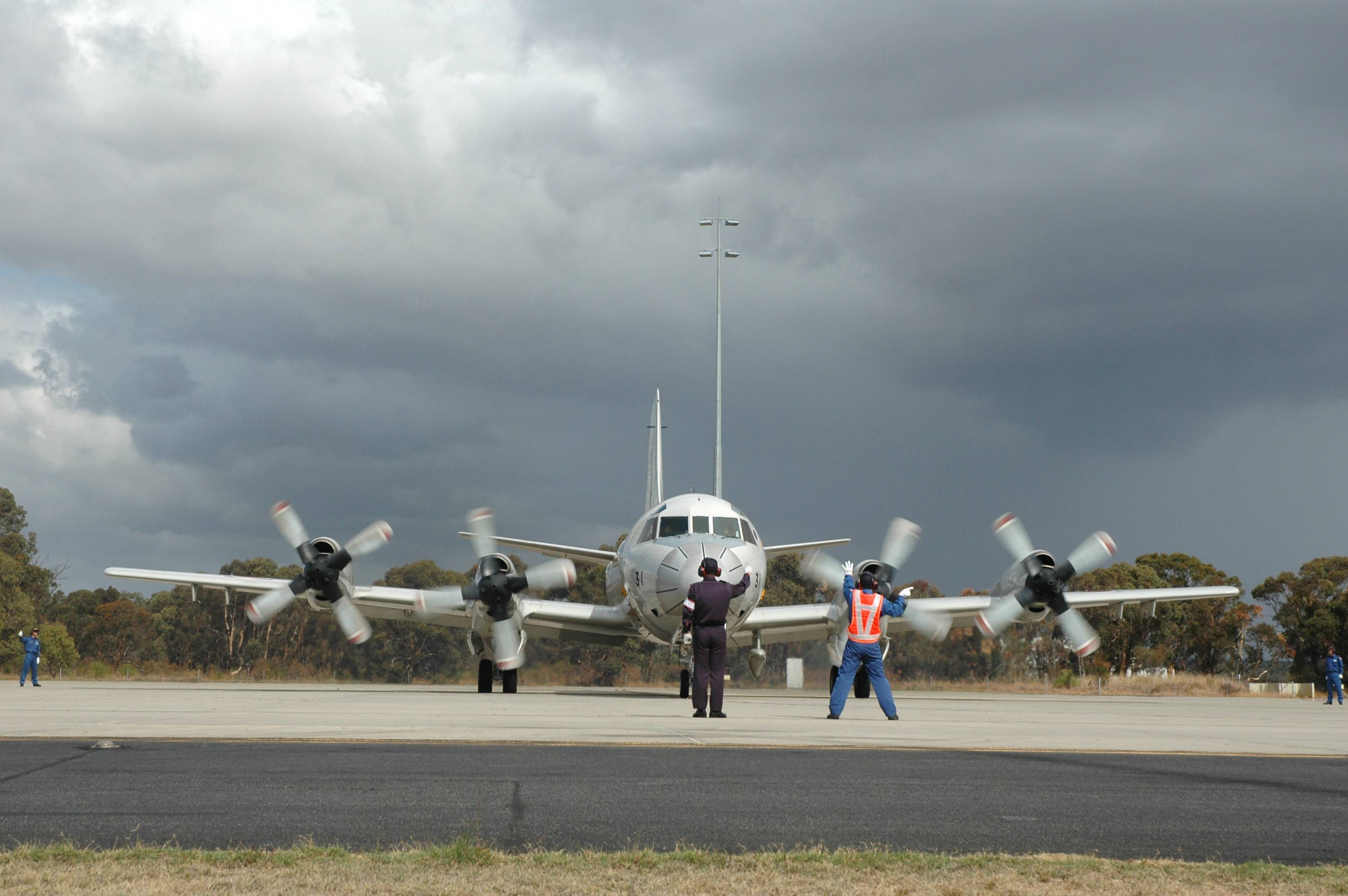 A Japanese P-3C Orion is guided by ground crew as it taxis along the tarmac at RAAF Base Pearce before departing for Japan's final search flight for the missing Malaysia Airlines flight MH370, Monday.