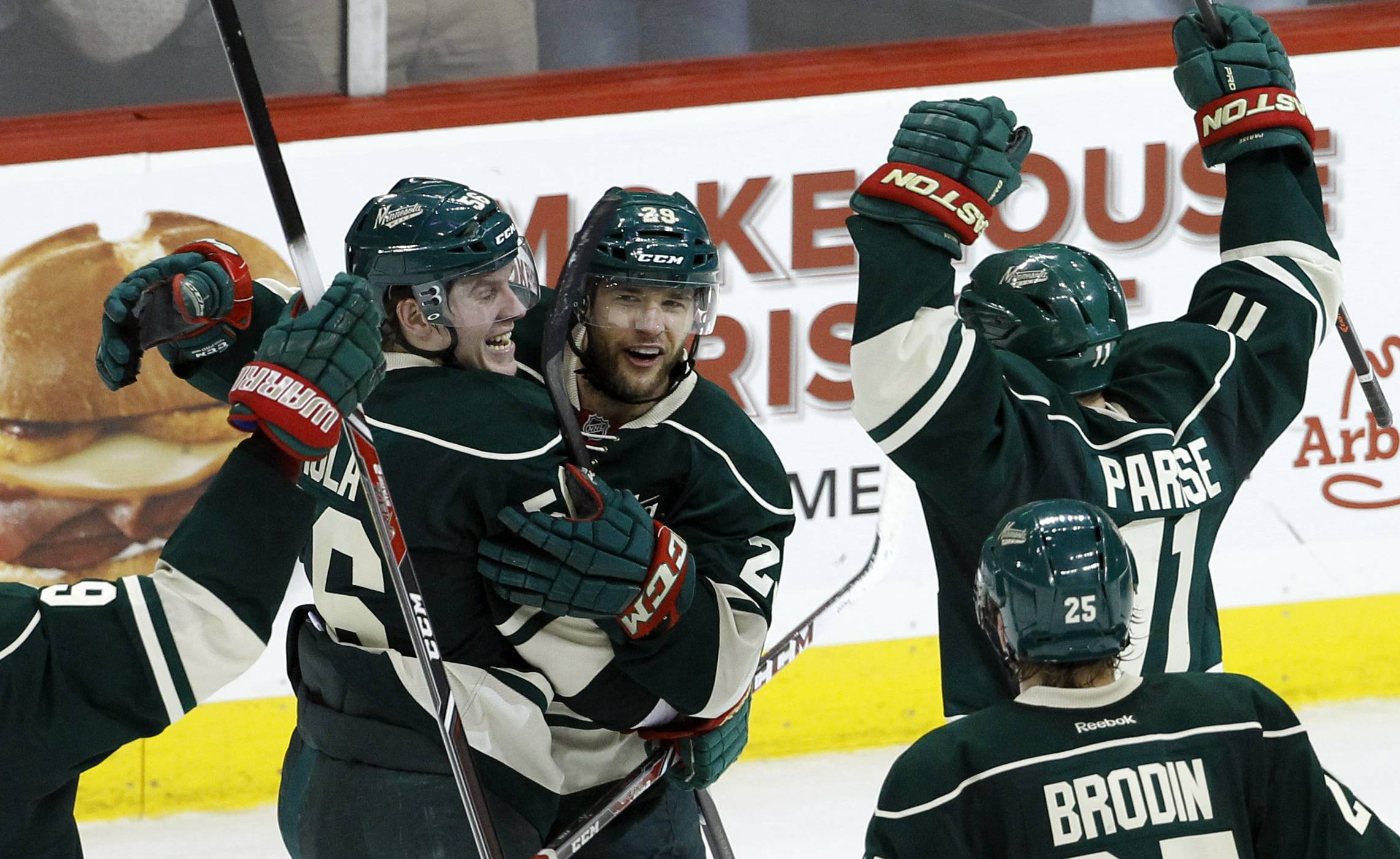 Minnesota Wild left wing Erik Haula, left, of Finland; right wing Jason Pominville, center; and left wing Zach Parise (11) celebrate Pominville's empty-net goal during the third period of Game 6 of the NHL hockey first-round playoff series against the Colorado Avalanche in St. Paul, Minn., Monday.