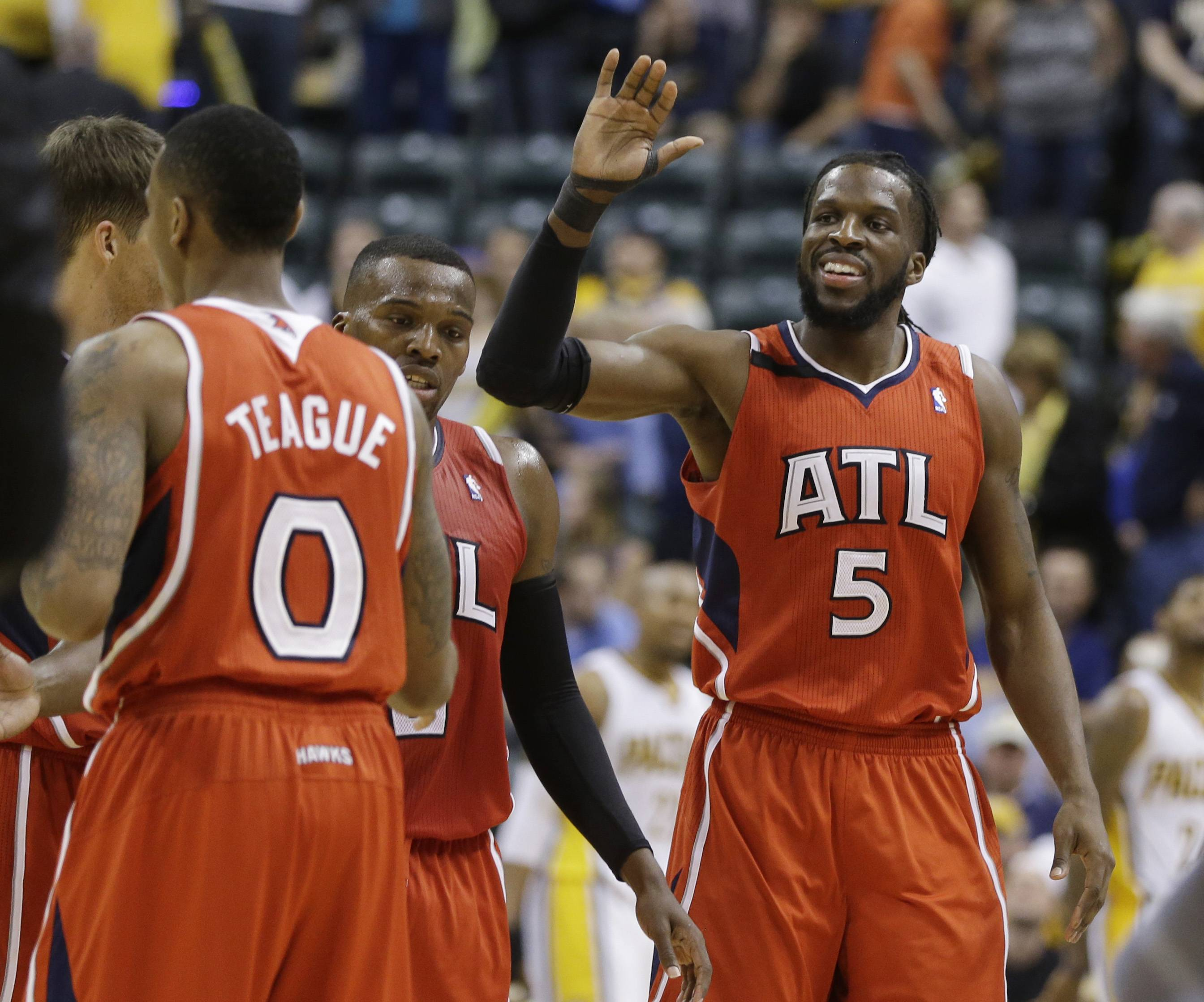 Atlanta Hawks' DeMarre Carroll (5) celebrates with his teammates late in the second half in Game 5 of the opening-round NBA basketball playoff series against the Indiana Pacers Monday in Indianapolis. Atlanta defeated Indiana 107-97.