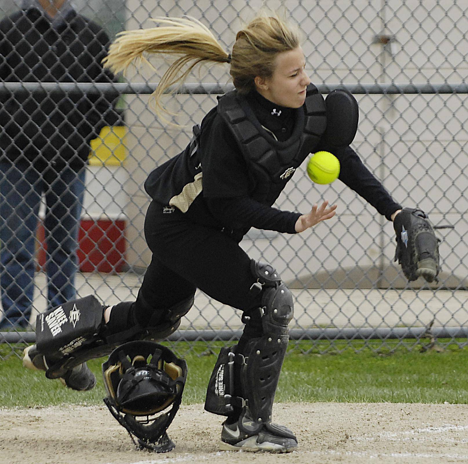 Streamwood catcher Natalie Filippo trips over her mask and misses a foul ball pop up off the bat of Batavia's Rachael Lovestrand in the first inning Monday in Batavia. Lovestrand then hit an RBI triple to start the three-score inning.