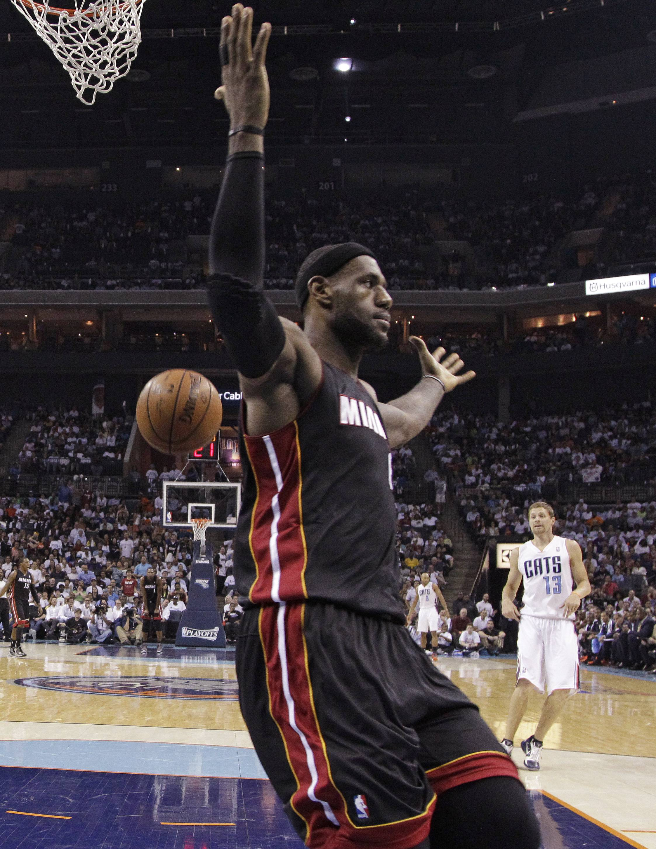 Miami Heat's LeBron James gestures after dunking against the Charlotte Bobcats during the first half.