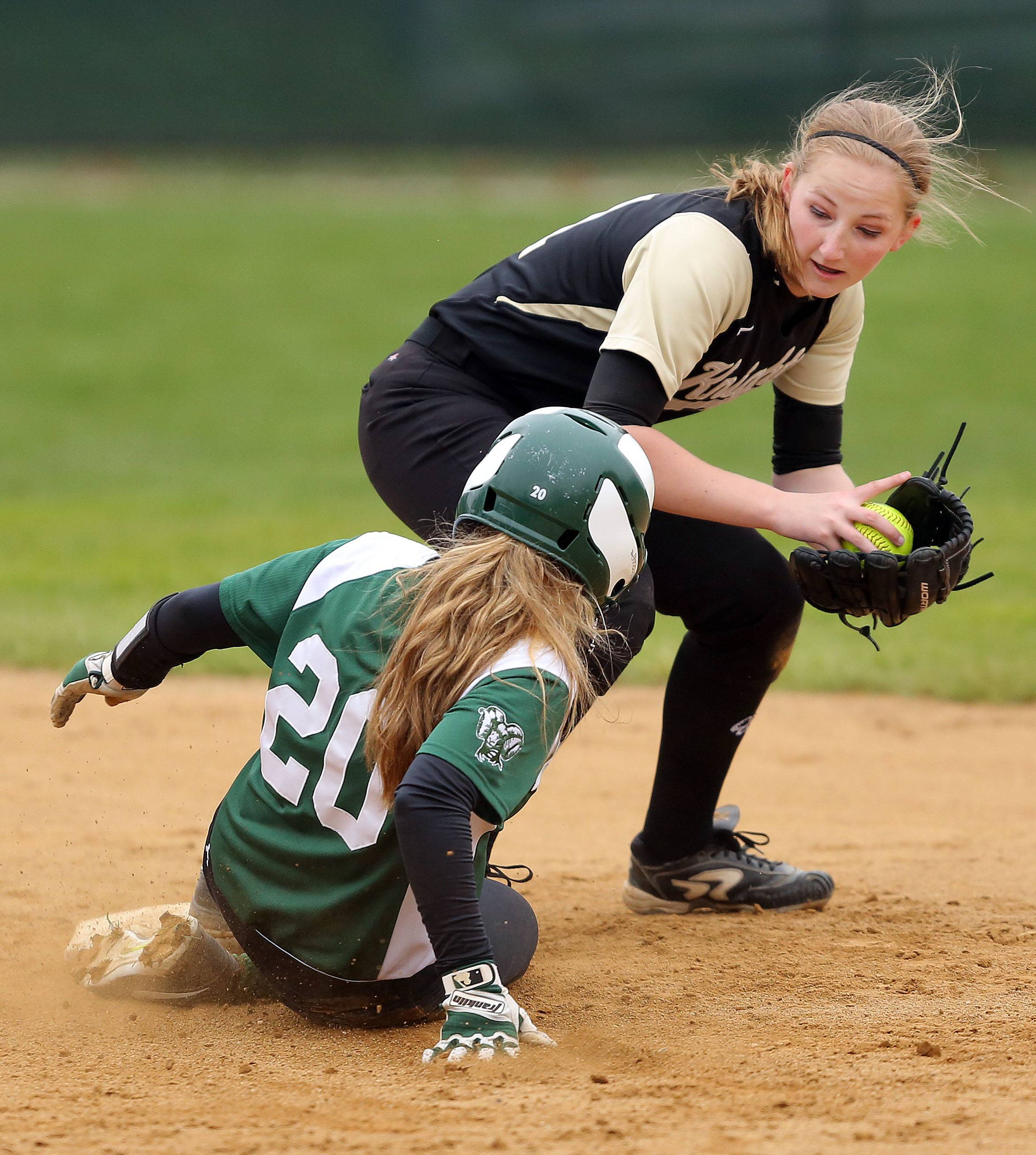 Grayslake Central's Teagan Truskowski, bottom, slides safely into second as Grayslake North's Jessica Vaughn makes the play Monday at Grayslake Central.