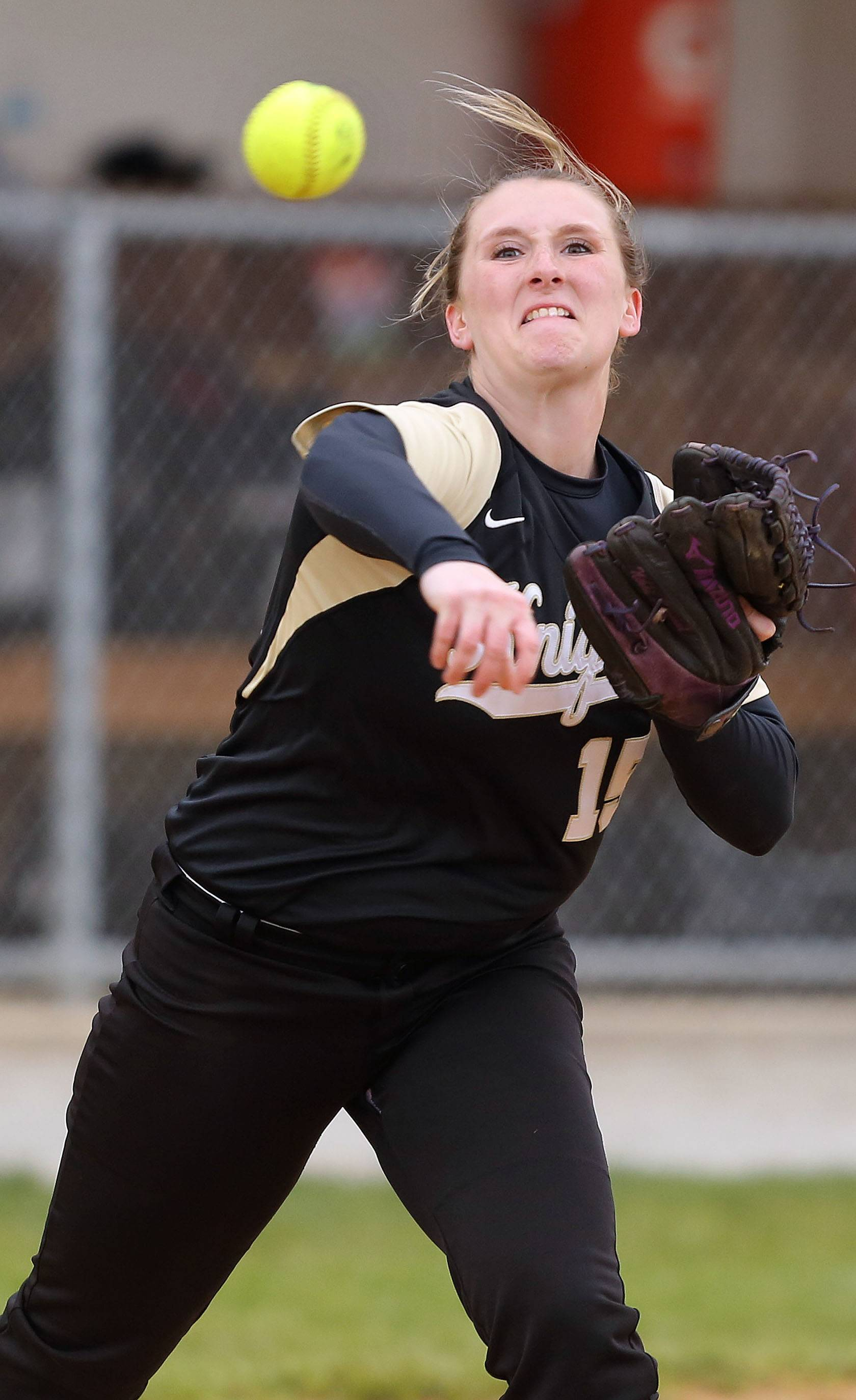 Steve Lundy/slundy@dailyherald.comGrayslake North's Nikki Livengood fires to first base on Monday at Grayslake Central.