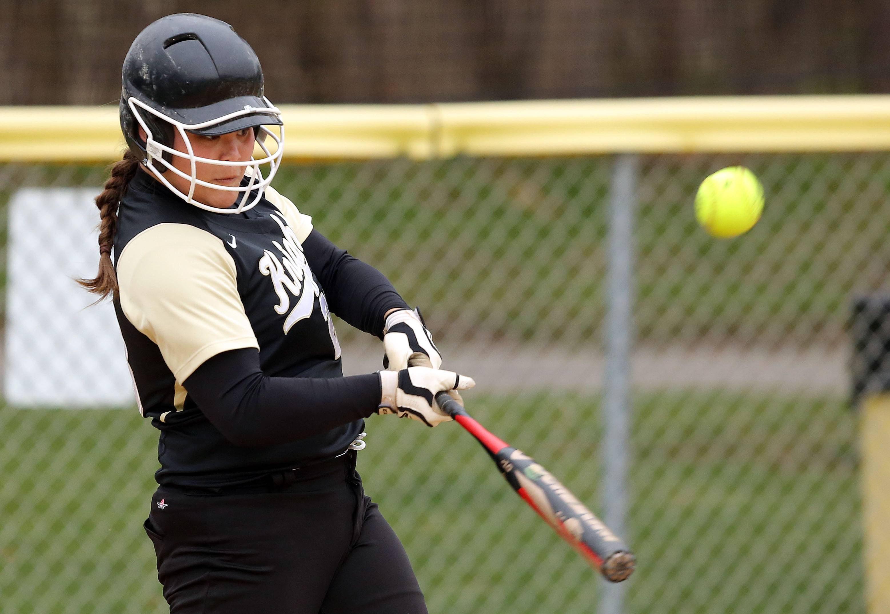 Grayslake North's Sarah Littleton connects on Monday at Grayslake Central.