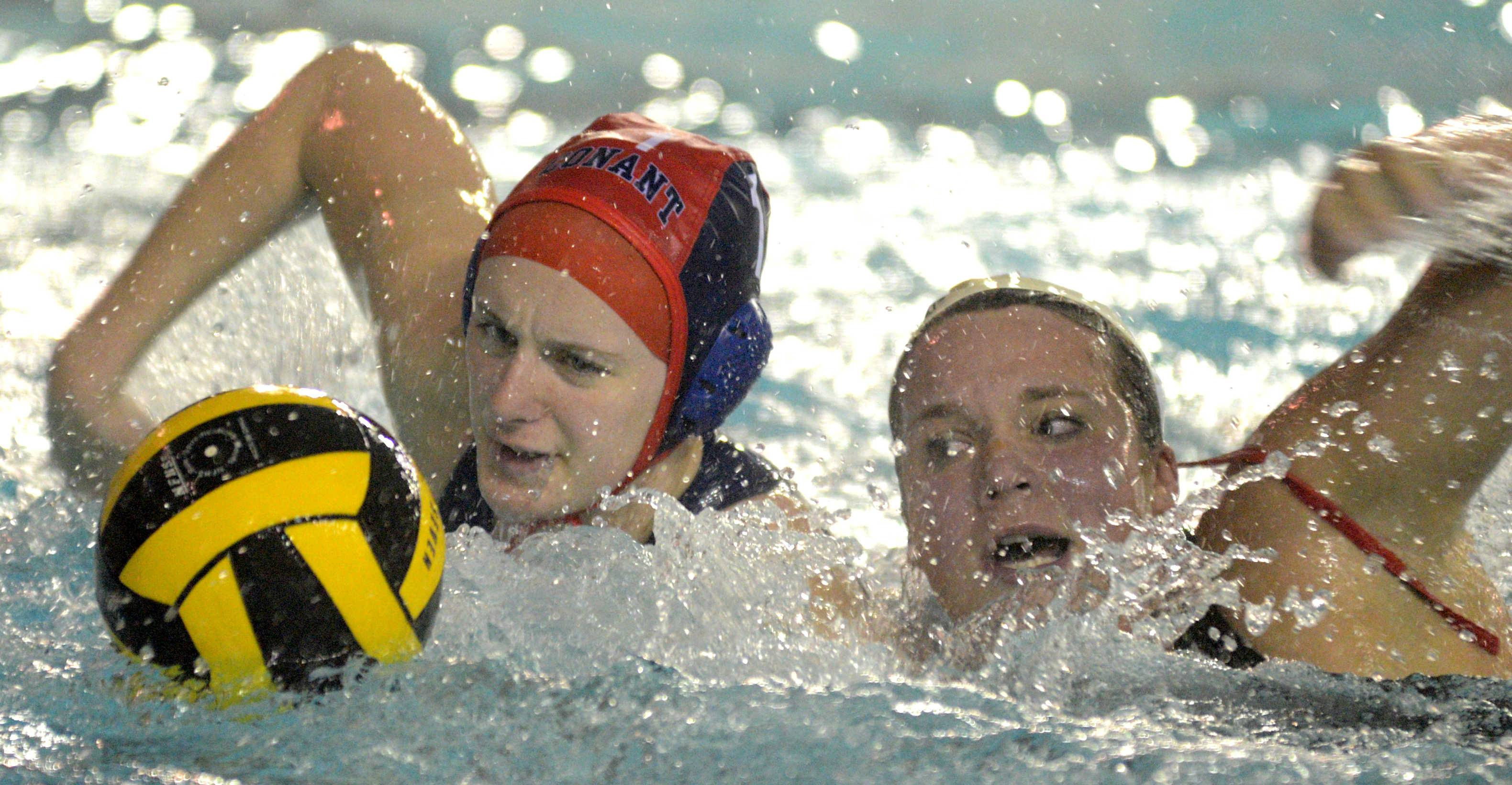 Palatine's Rachel Chumbook, right, and Conant's goalie Maddy Demaret battle for a possession on Monday at Conant.