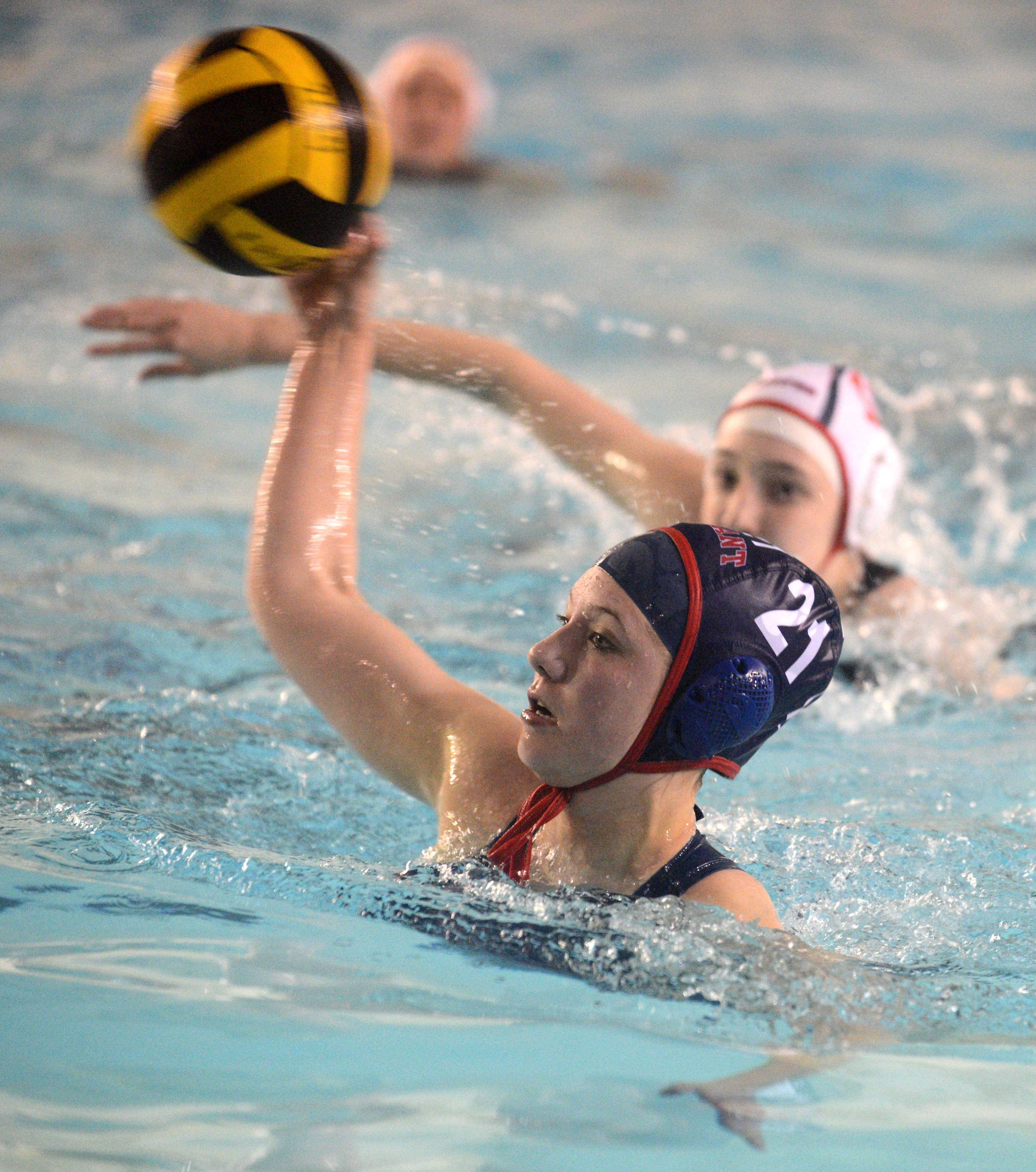 Conant's Emily Weingart takes a shot against Palatine during Monday's matchup at Conant.