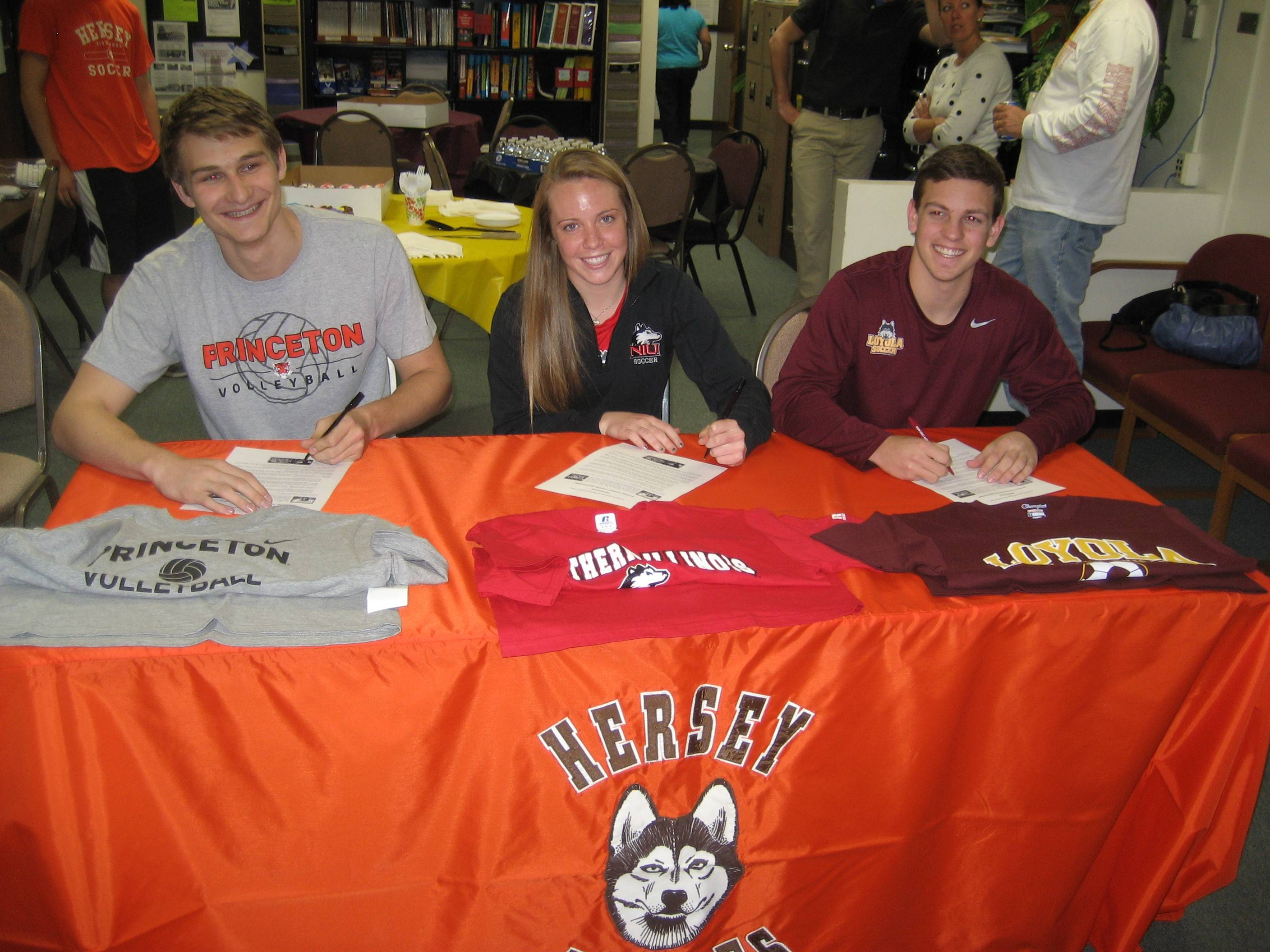 From left, Hersey's Mike Fuerst, Lauren Gierman and John Cappuccitti sign their national letters of intent.