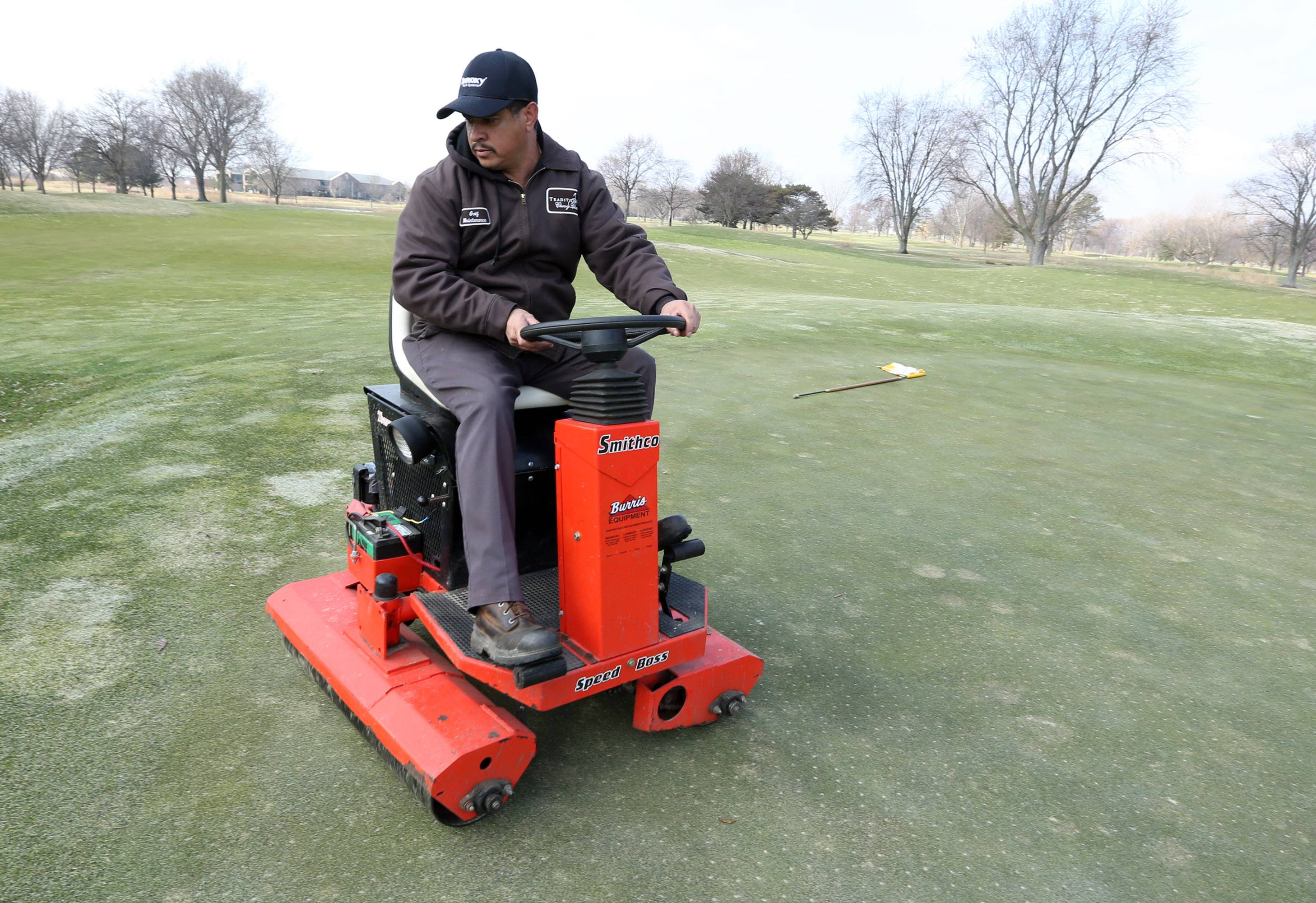 Alejandro Mata, greens keeper, operates a sidewinder roller at Chevy Chase Golf Course in Wheeling.