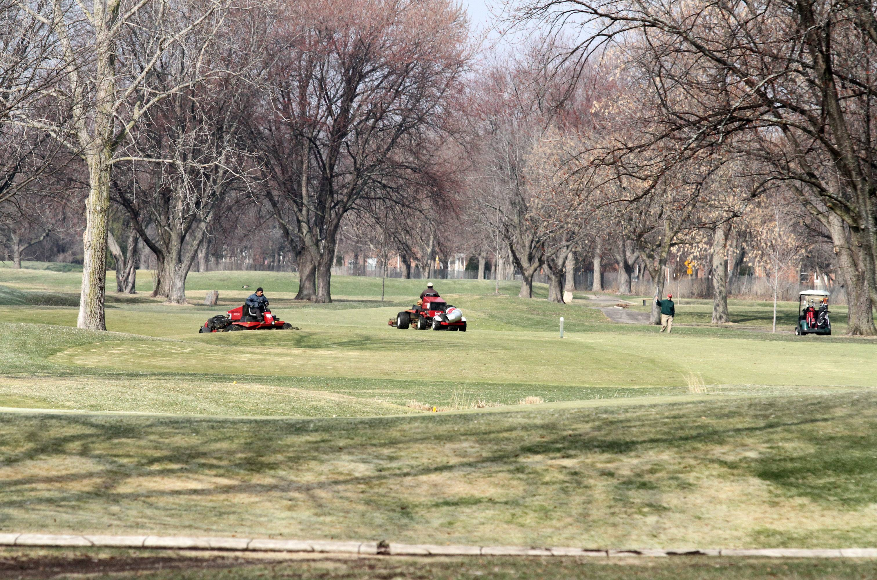George LeClaire/gleclaire@dailyherald.comGreens keepers cutting the fairway at Chevy Chase Golf Course on Tuesday in Wheeling.