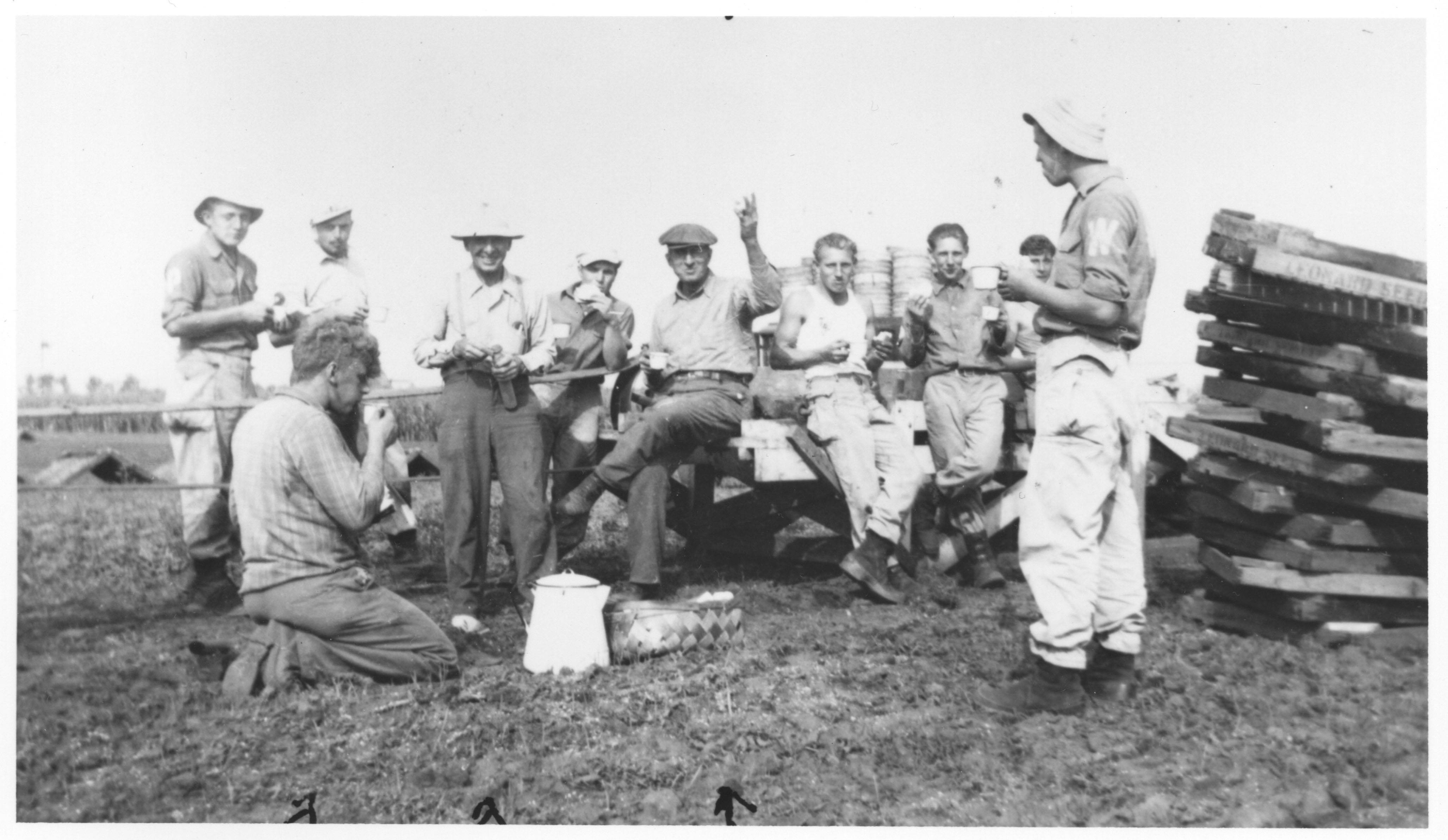 These German POWS lived at Camp Pine, in Des Plaines, during World War II. They are shown eating lunch at the Mahler Farm where they worked. Also pictured are Fred Mahler, August Sell and Russell Mahler.