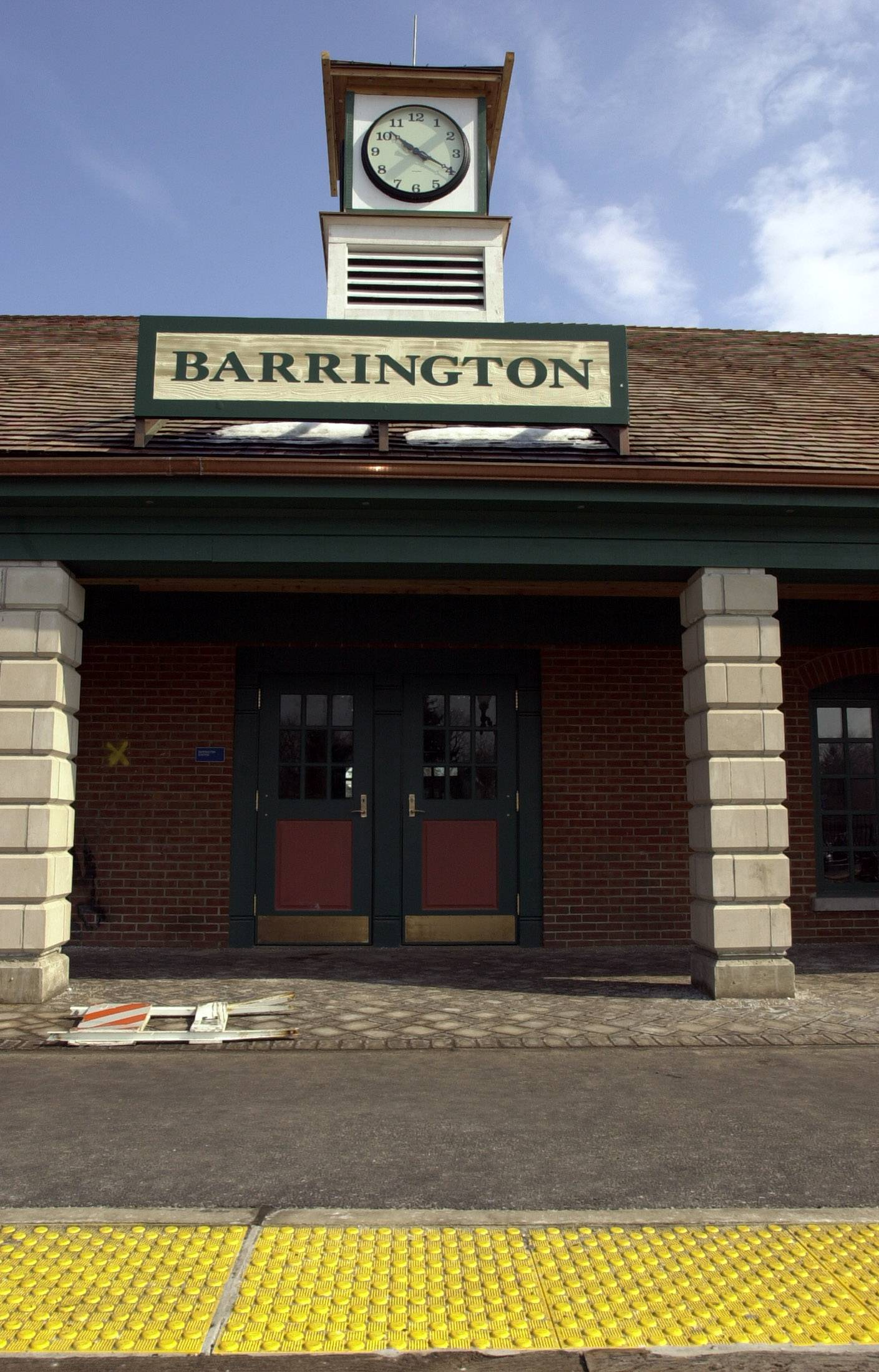 Renovations to the exterior of the Barrington Metra station began Monday, just hours before village leaders got the good news that costs associated with the work would be lower than expected. Workers will rip up the crumbling brick walkways and replace them with colored, stamped concrete.