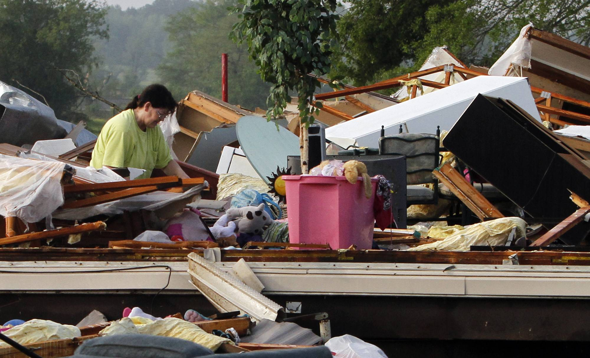 Teresa Ingram looks for belongings in the debris Tuesday after a tornado passed through destroying Billy Barbs mobile home park in Athens, Ala. A dangerous storm system that spawned a chain of deadly tornadoes over three days flattened homes and businesses, forced frightened residents in more than half a dozen states to take cover and left tens of thousands in the dark Tuesday morning.