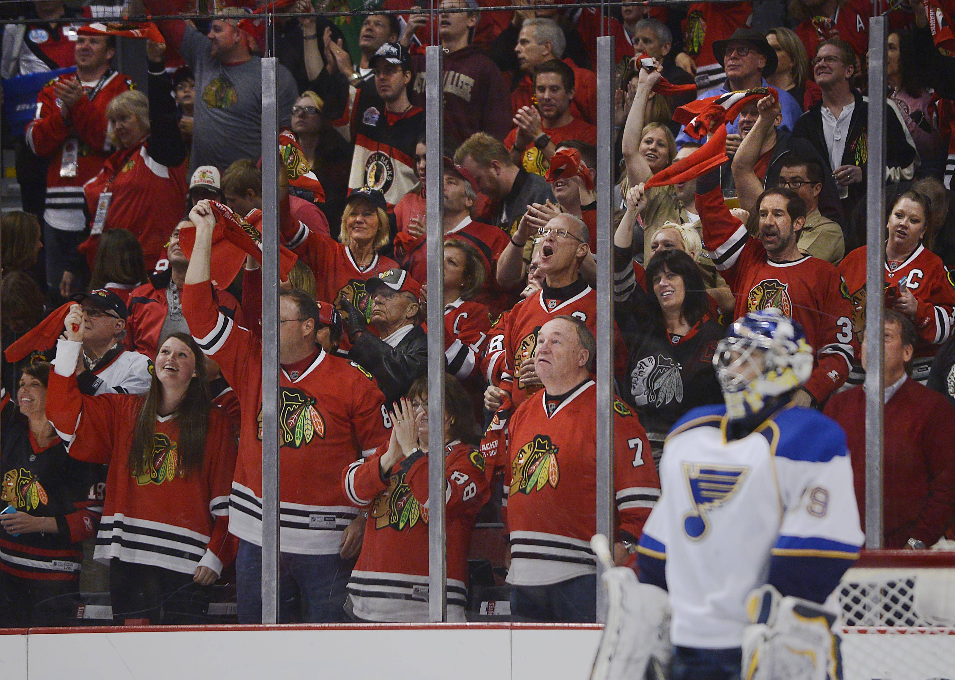 John Starks/jstarks@dailyherald.com The home team fans celebrate Brian Bickell's goal in the first period as St. Louis Blues goalkeeper Ryan Miller stands motionless Sunday in Game 6. The Hawks won four straight game to capture the series 4-2 and move on in the playoffs.