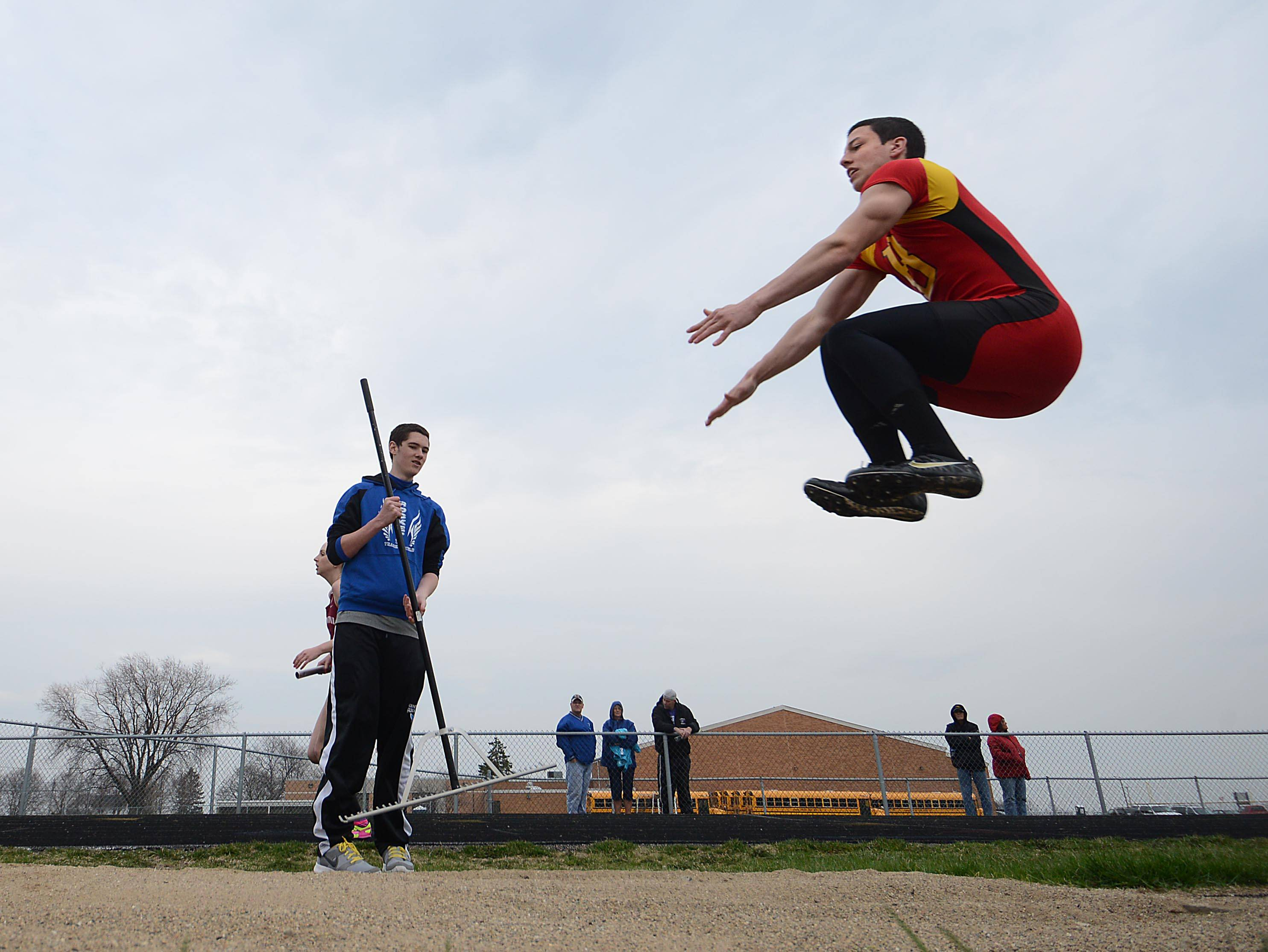Batavia's David Sharp competes in the long jump Thursday at the Rocket Relays track invitational at Burlington Central High School.