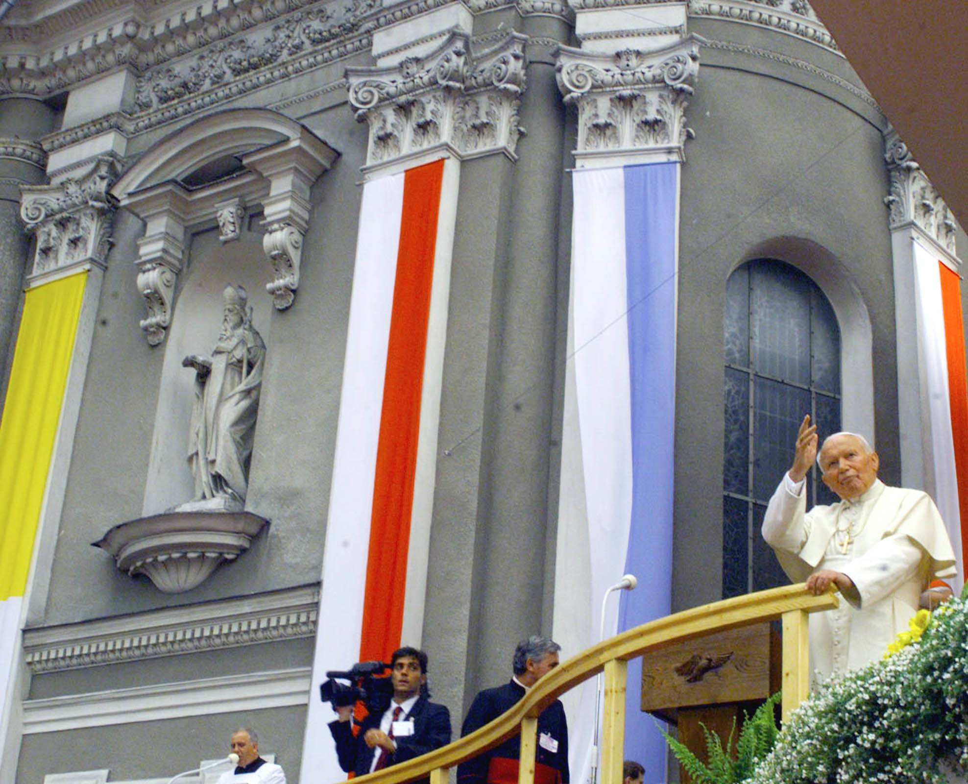 In 1999, Pope John Paul II waves from outside the basilica during his visit to Wadowice, Poland, the town where he was born and grew up. The basilica was his parish church, where he was baptized, served as an altar boy and stopped to pray on his way to school. A central point in Wadowice, the basilica has a chapel dedicated to John Paul with a reliquary containing a drop of his blood.