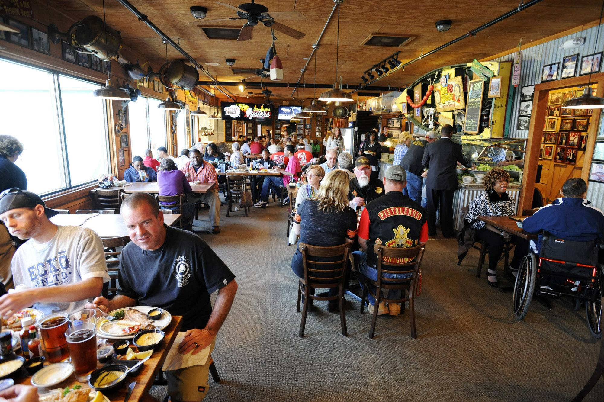 Diners pack the Original Oyster House in Spanish Fort, Ala.