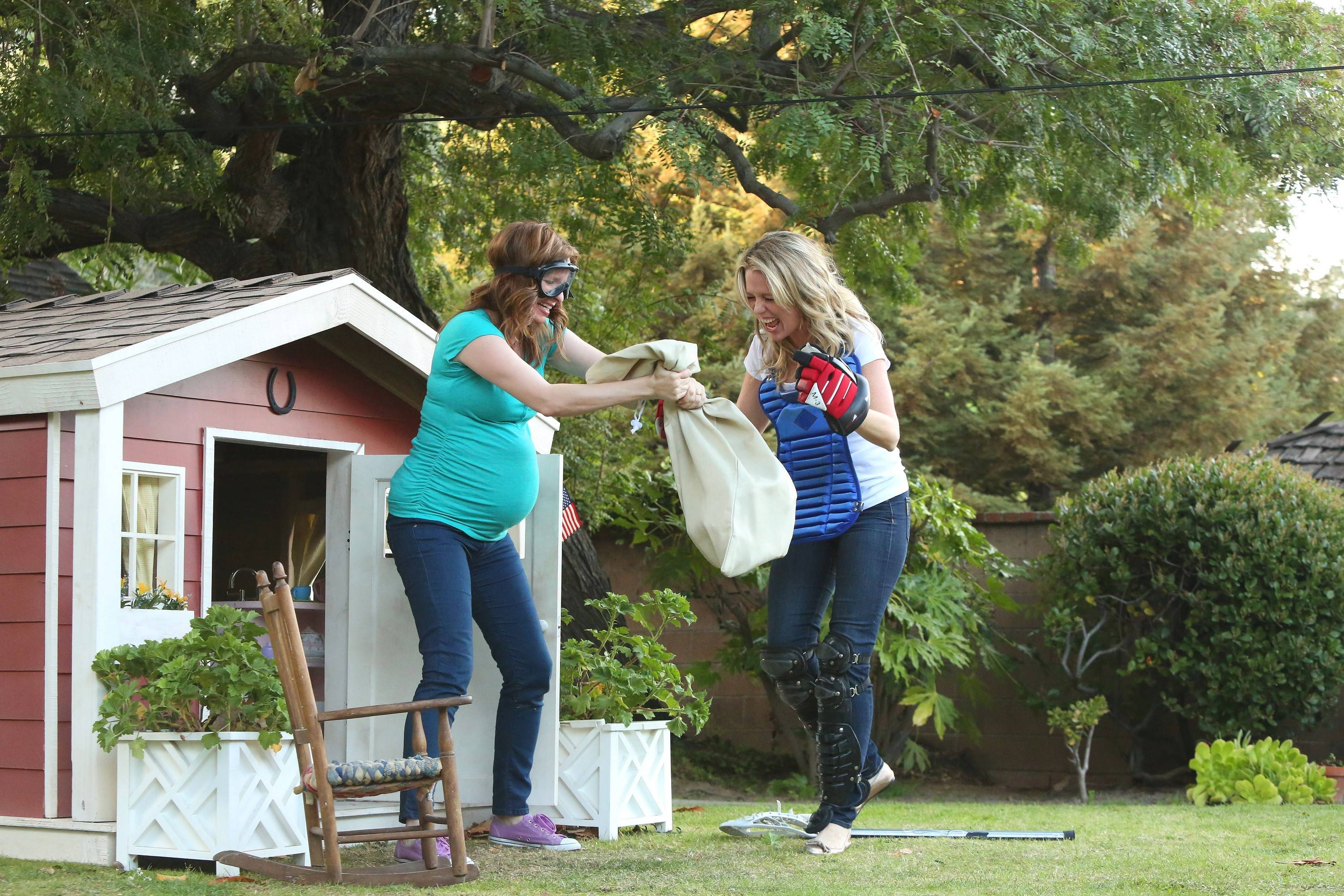 "Pregnant Maggie (Lennon Parham) gets some help from best friend Emma (Jessica St. Clair) in USA's ""Playing House."""