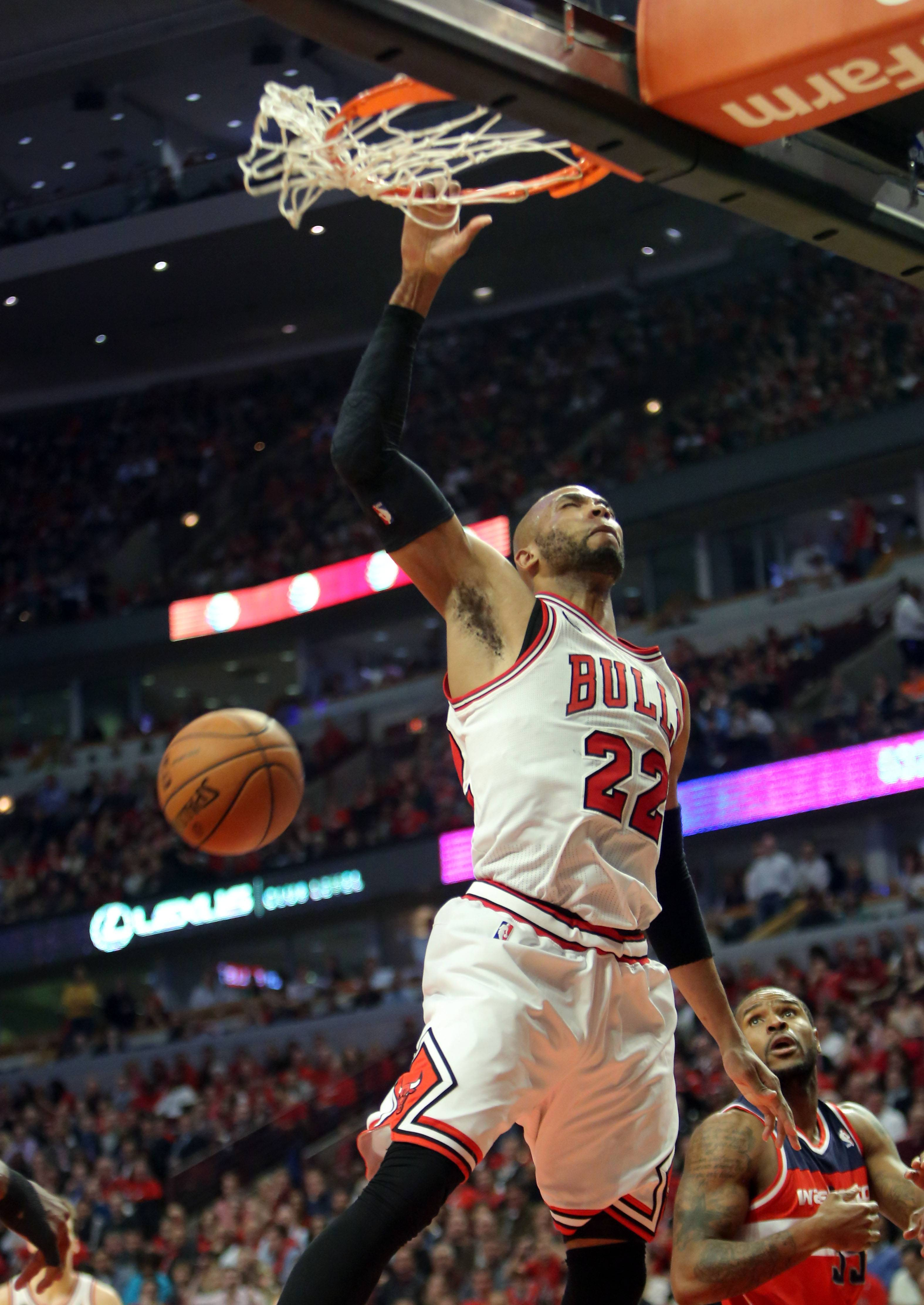 Chicago Bulls forward Taj Gibson goes in for a dunk.