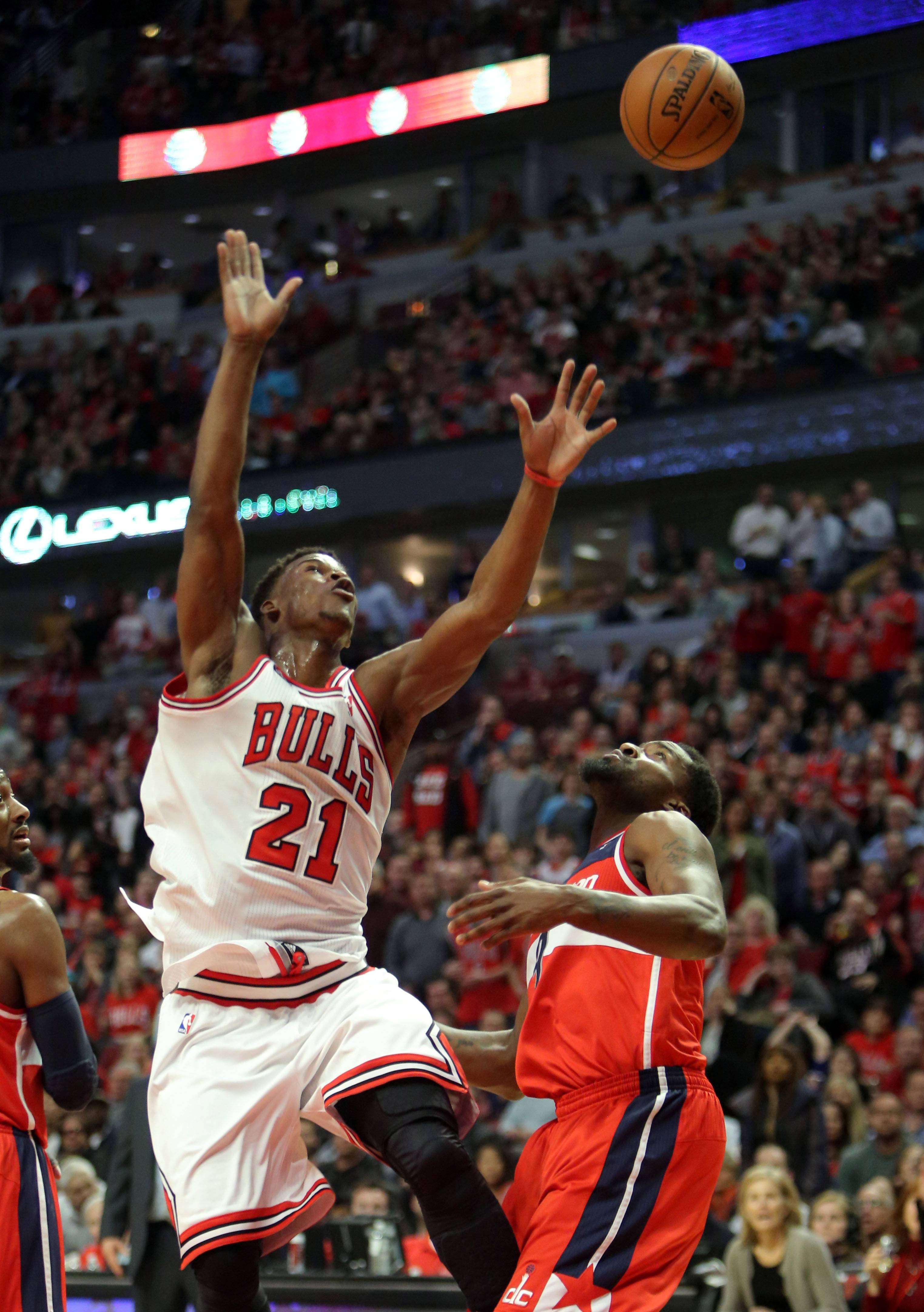 Chicago Bulls guard Jimmy Butler goes for a rebound.