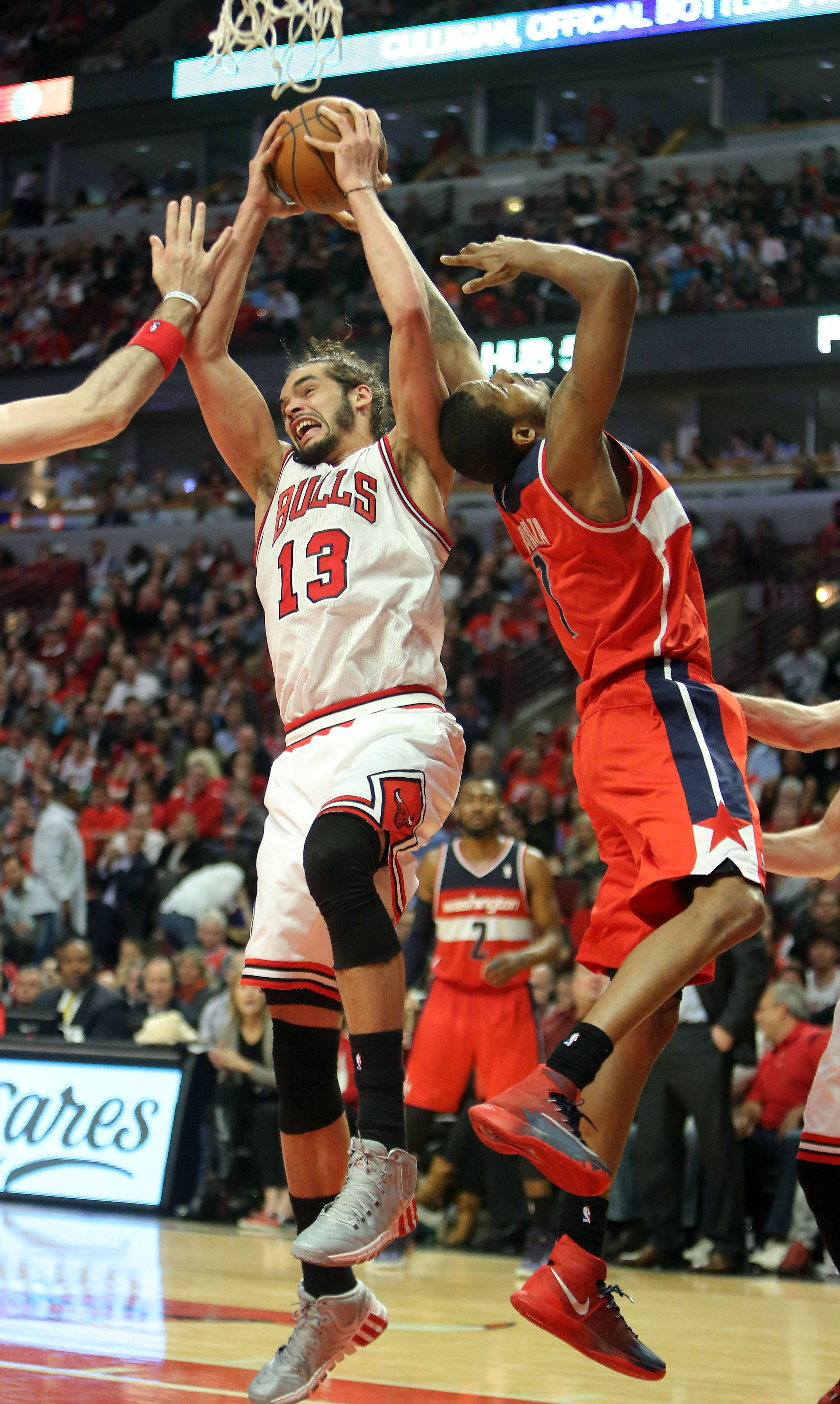 Chicago Bulls center Joakim Noah pulls down a rebound over Washington Wizards forward Trevor Ariza.