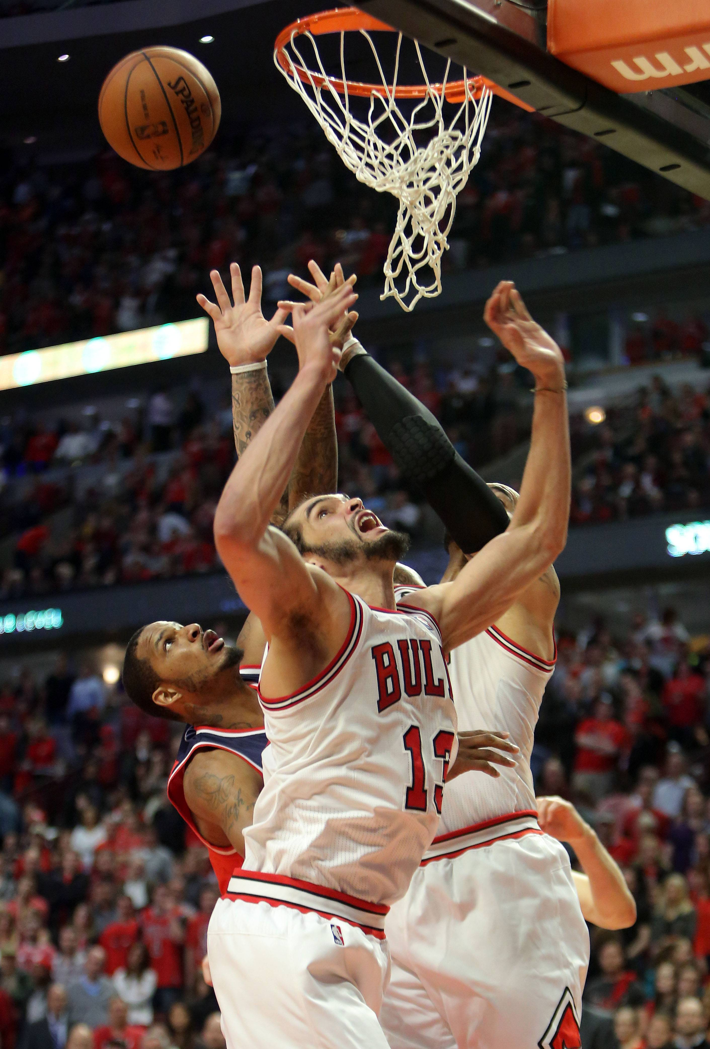 Chicago Bulls center Joakim Noah goes for a rebound.