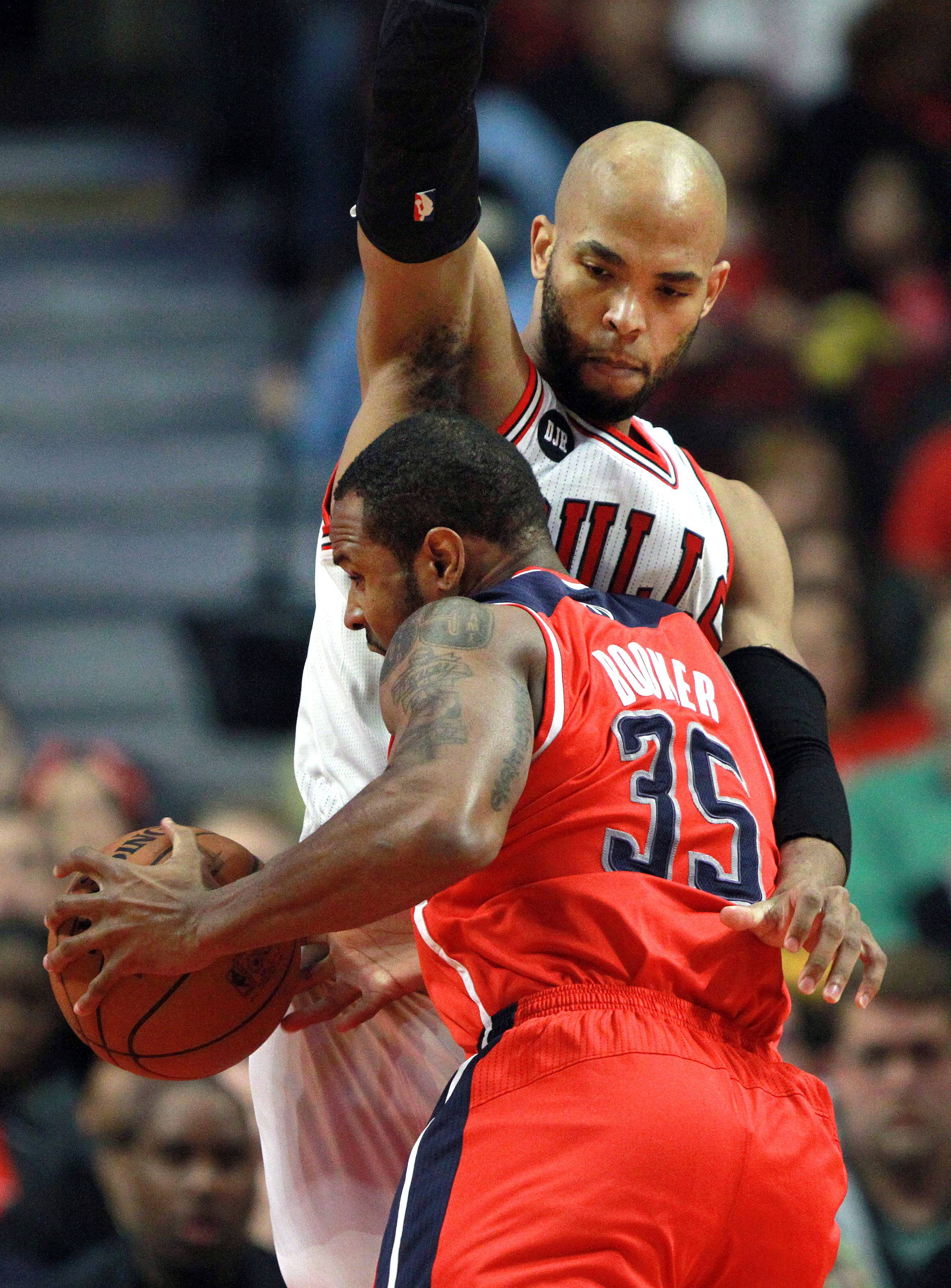 Washington Wizards forward Trevor Booker drives on Chicago Bulls forward Taj Gibson.