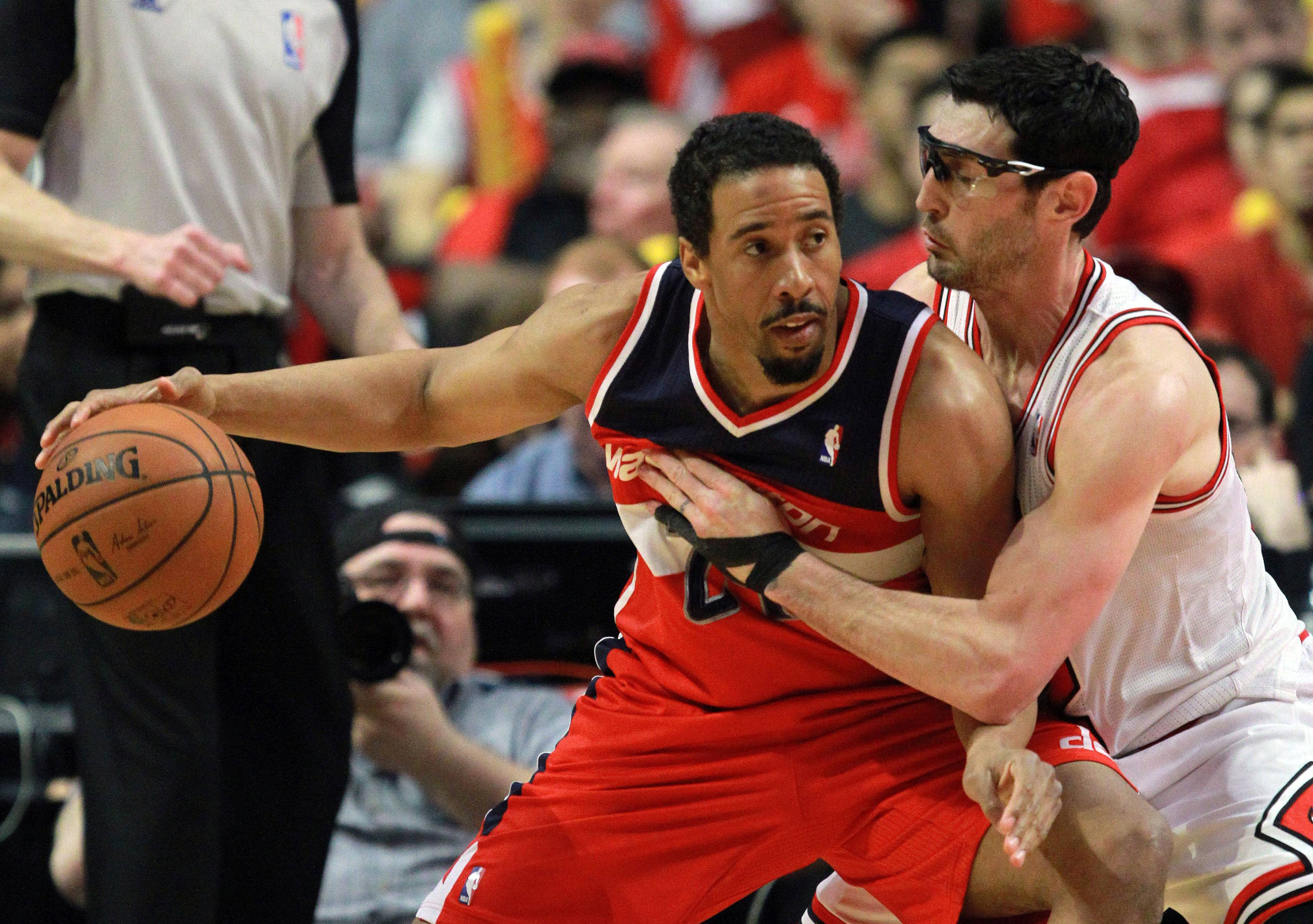 Washington Wizards guard Andre Miller backs in on Chicago Bulls guard Kirk Hinrich.