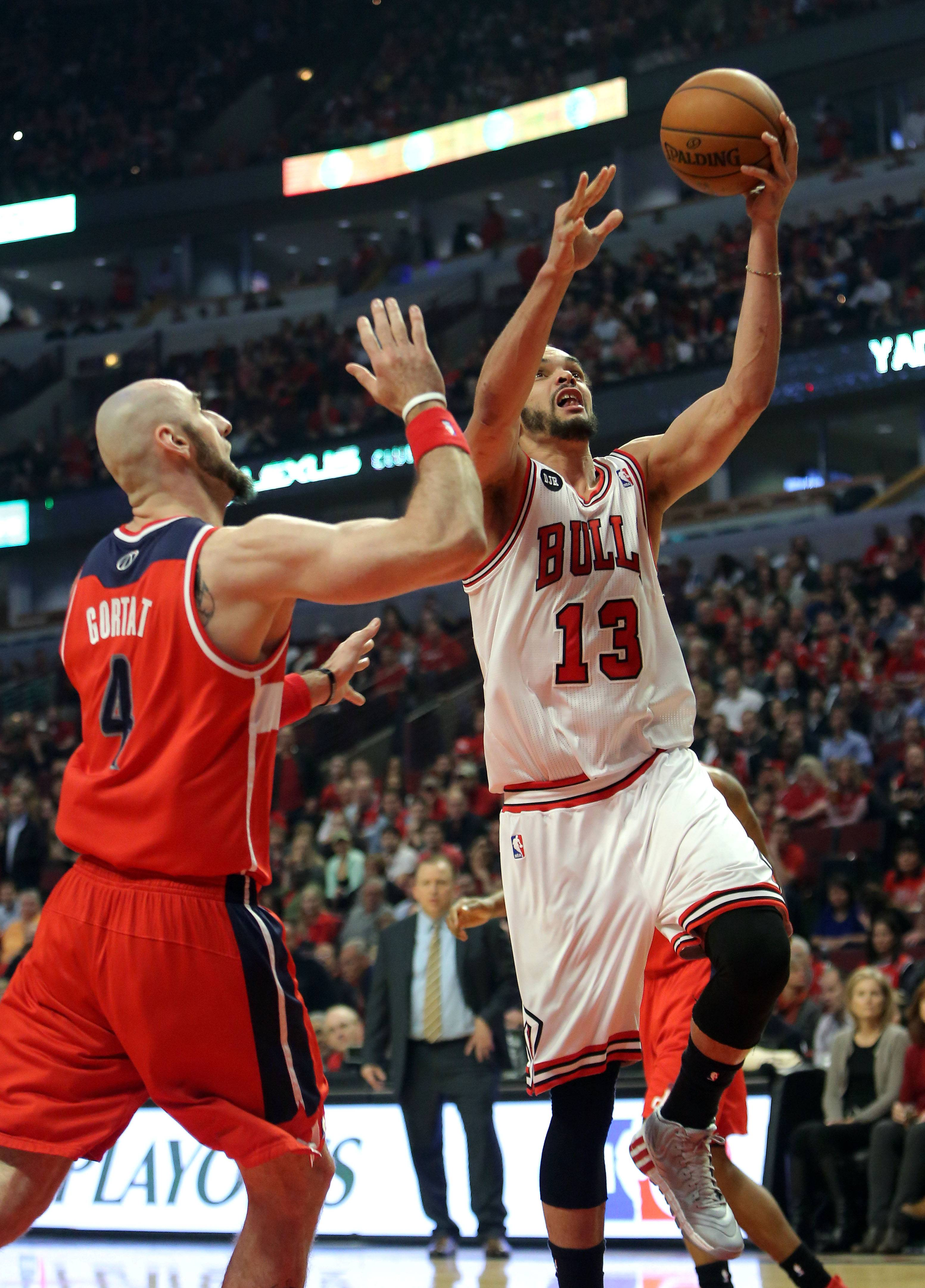 Chicago Bulls center Joakim Noah drives on Washington Wizards center Marcin Gortat .
