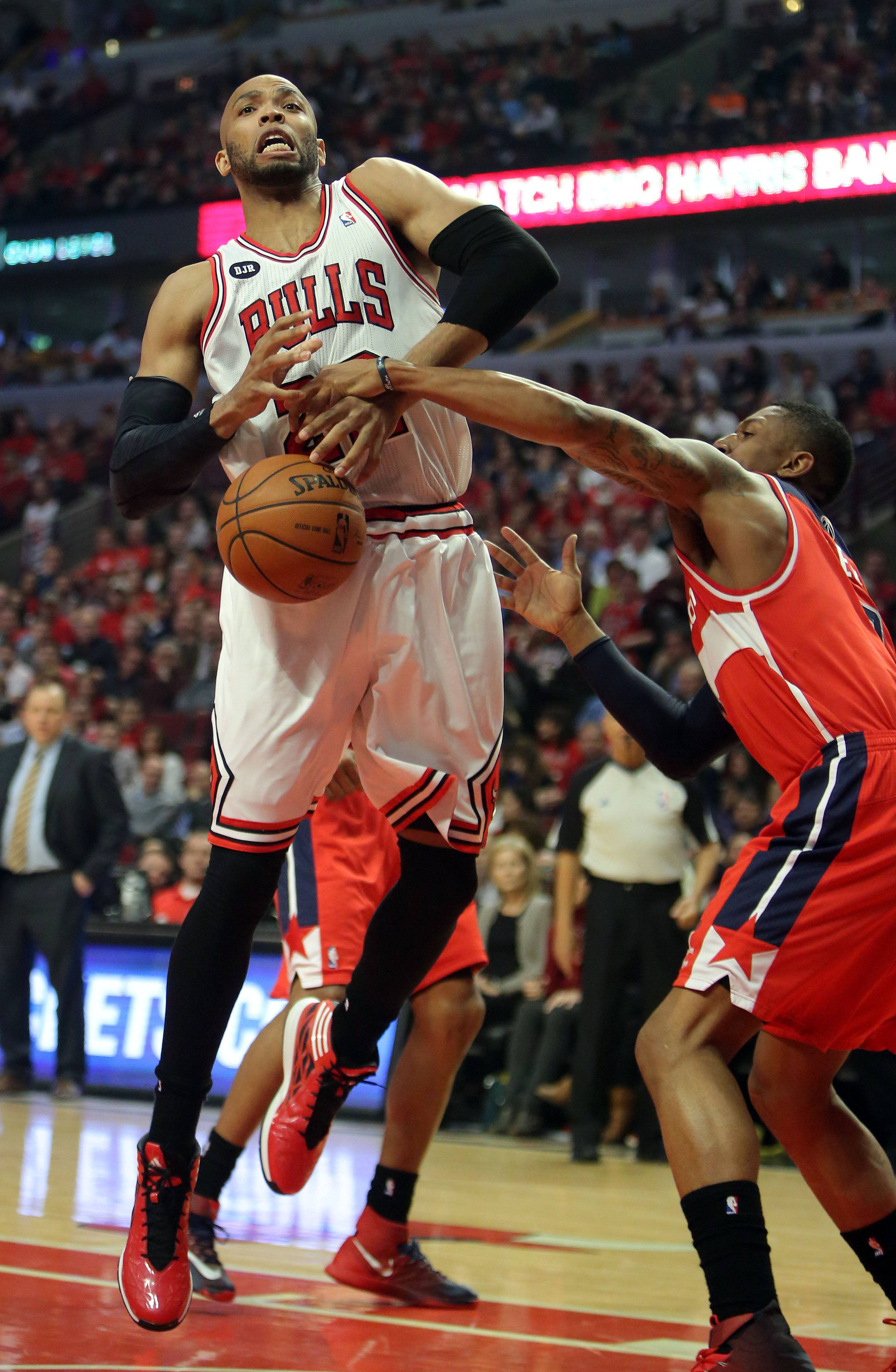 Chicago Bulls forward Taj Gibson gets the ball stripped by Washington Wizards guard John Wall.