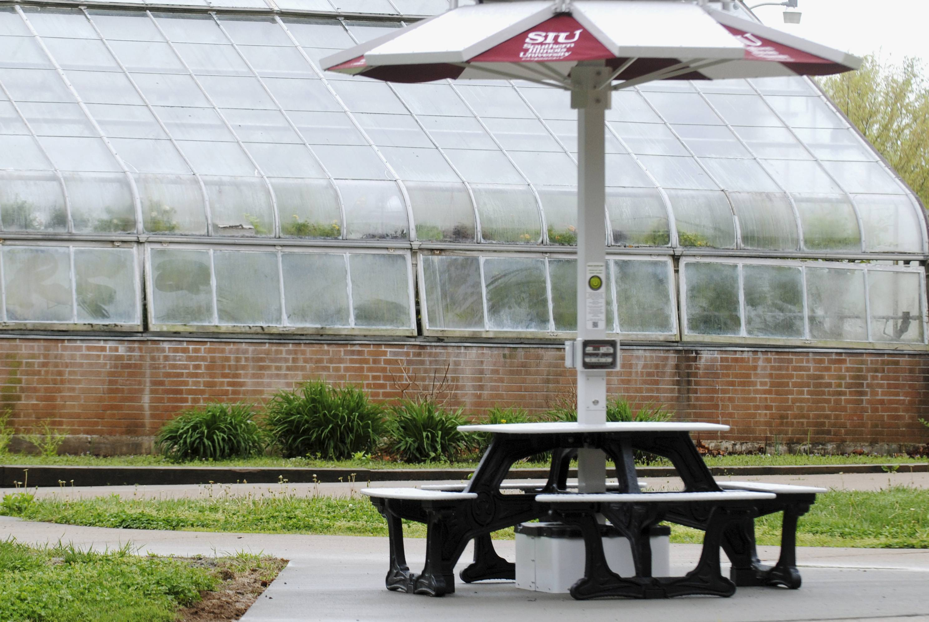 The solar-powered picnic table is near the Life Sciences building and greenhouse at the Southern Illinois University campus in Carbondale.
