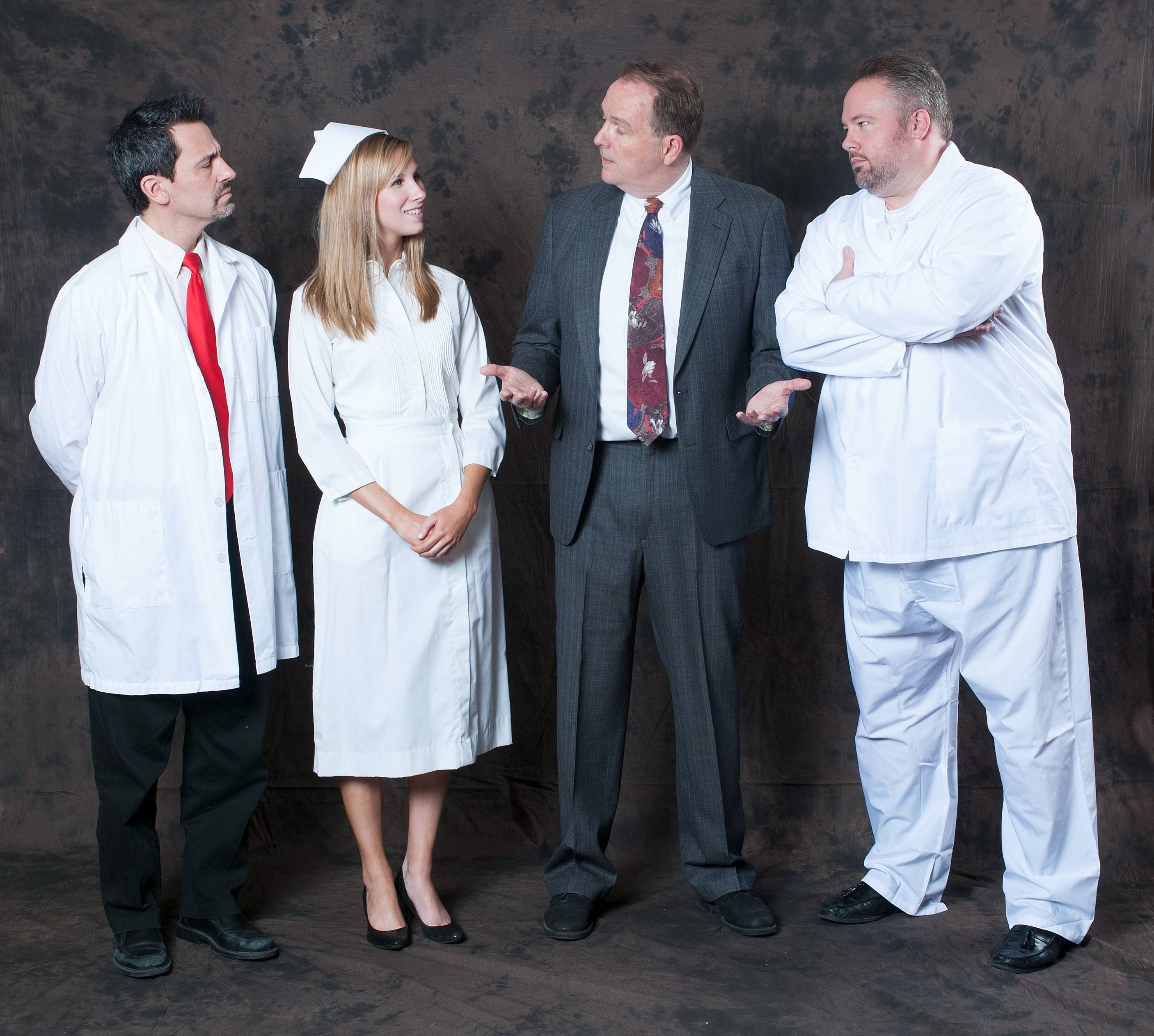 "Members of the sanitarium's staff try to get a sense of Elwood P. Dowd, played by Chuck Jacobson, in ""Harvey"" at GreenMan Theatre. The cast also includes, from left, Jerry Moore, Dana Peters and Denis Duffy."