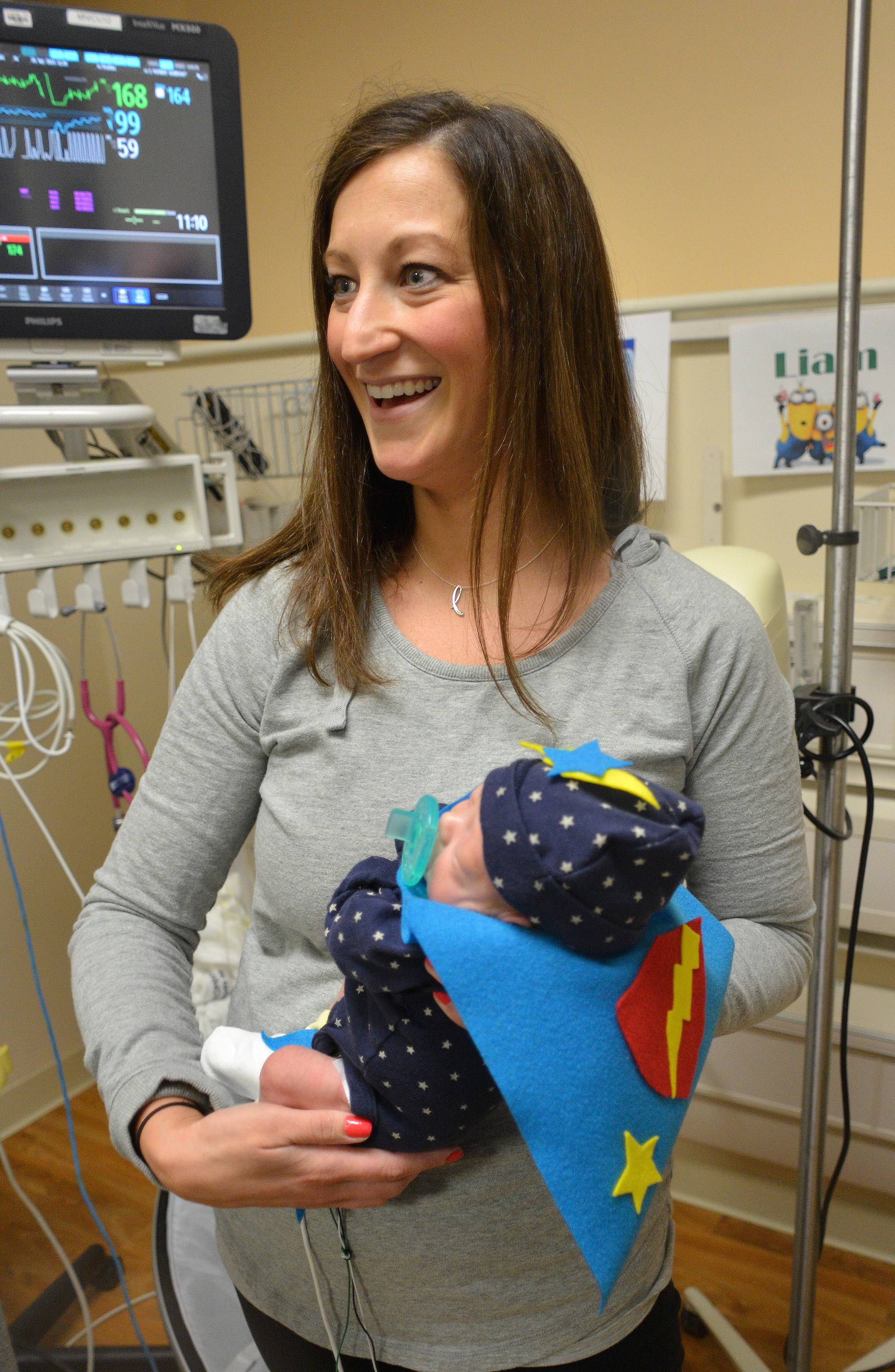 Even tiny patients in the neonatal intensive care unit at Central DuPage Hospital donned capes for National Superhero Day. Jaime Zilch of Wheaton holds her tiny superhero son, Liam.