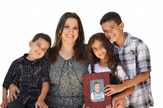 The photo of Adam, who died of complications for treatment to a rare disorder, remains a symbol of Naperville mom Angie Emara's personal jihad, or struggle, to cope with that loss and make life happy for her remaining sons, Amir, 12, and Aiman, 6, and her daughter, Lara, 8.