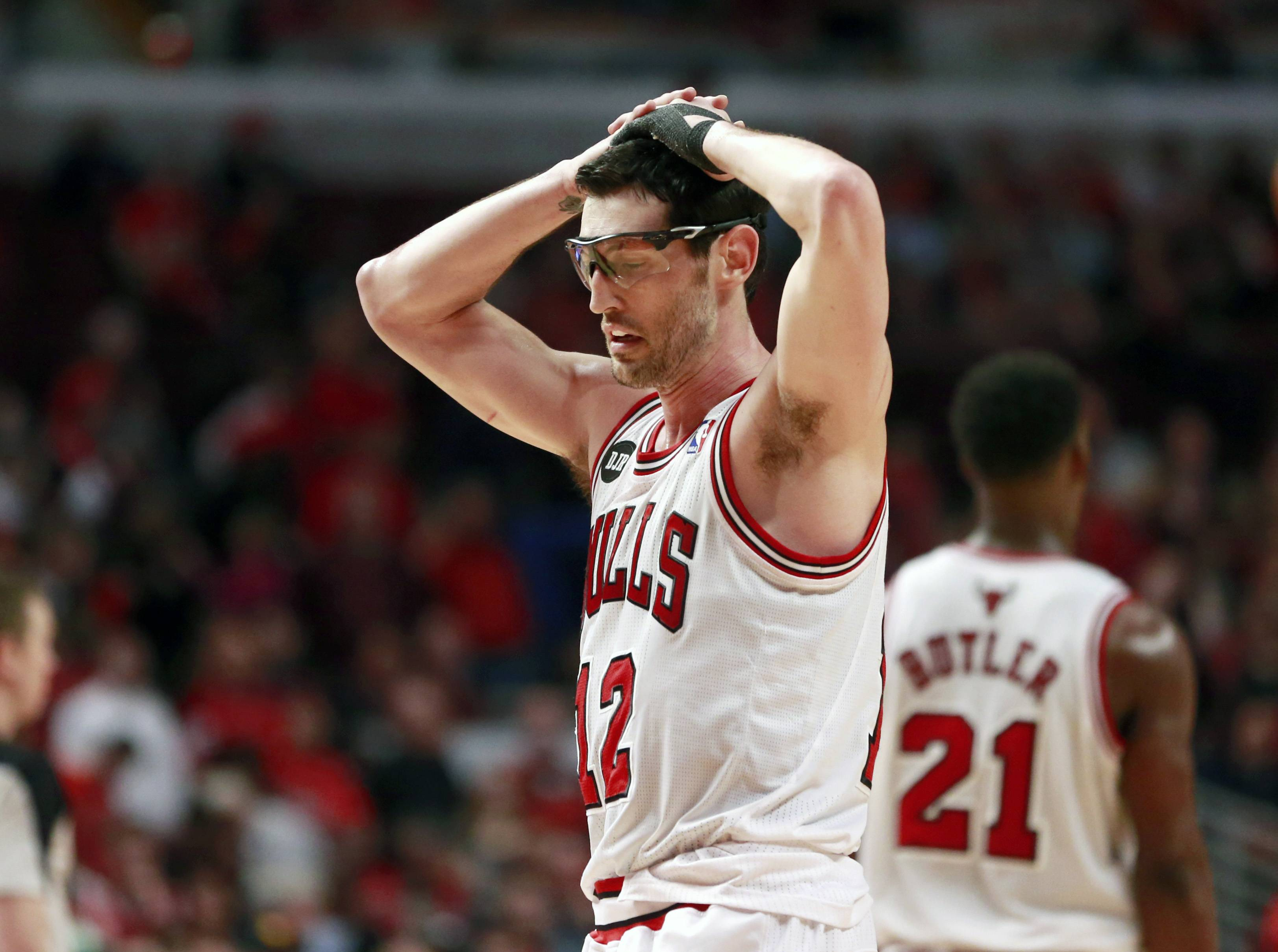 Bulls guard Kirk Hinrich puts his hands on his head after fouling out of Game 5 in an opening-round NBA basketball playoff series against the Washington Wizards, Tuesday, April 29, 2014, in Chicago. The Wizards won 75-69.