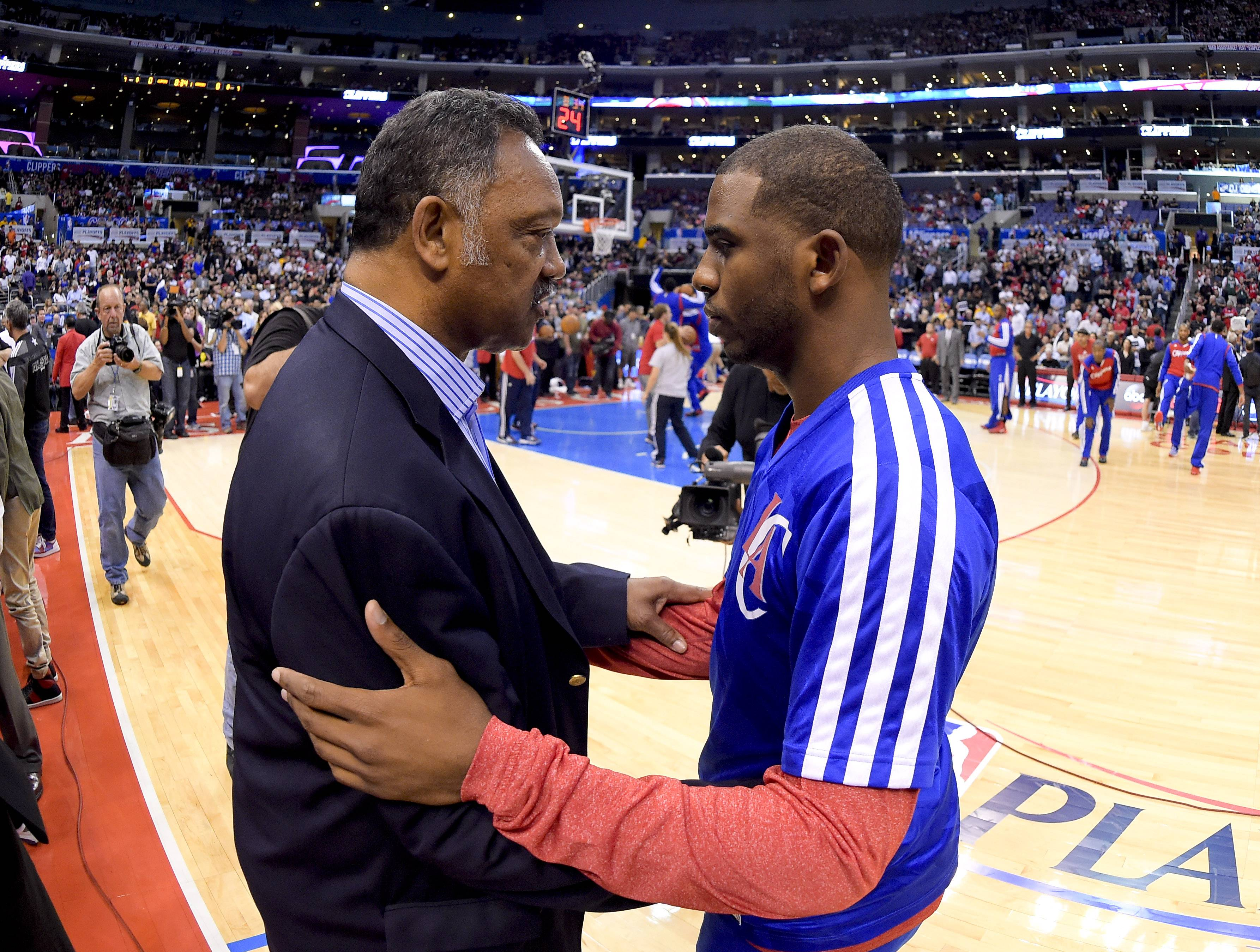 The Rev. Jesse Jackson, left, greets Los Angeles Clippers guard J.J. Redick before Game 5 of the Clippers' opening-round NBA basketball playoff series against the Golden State Warriors Tuesday in Los Angeles.