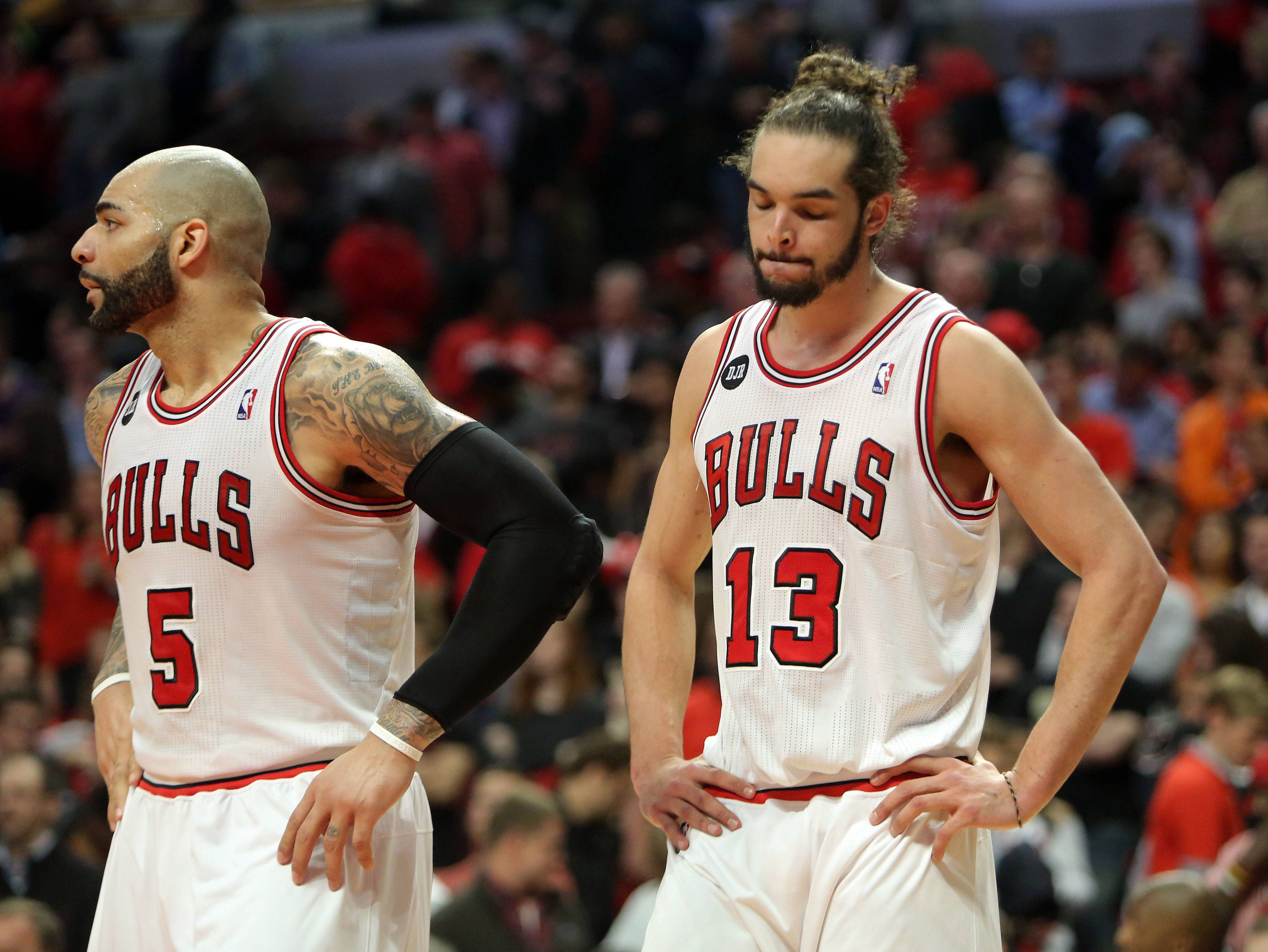 Chicago Bulls forward Carlos Boozer and Chicago Bulls center Joakim Noah react during the Bulls 75-69 loss in game five of first-round of the NBA playoffs Tuesday night at the United Center.