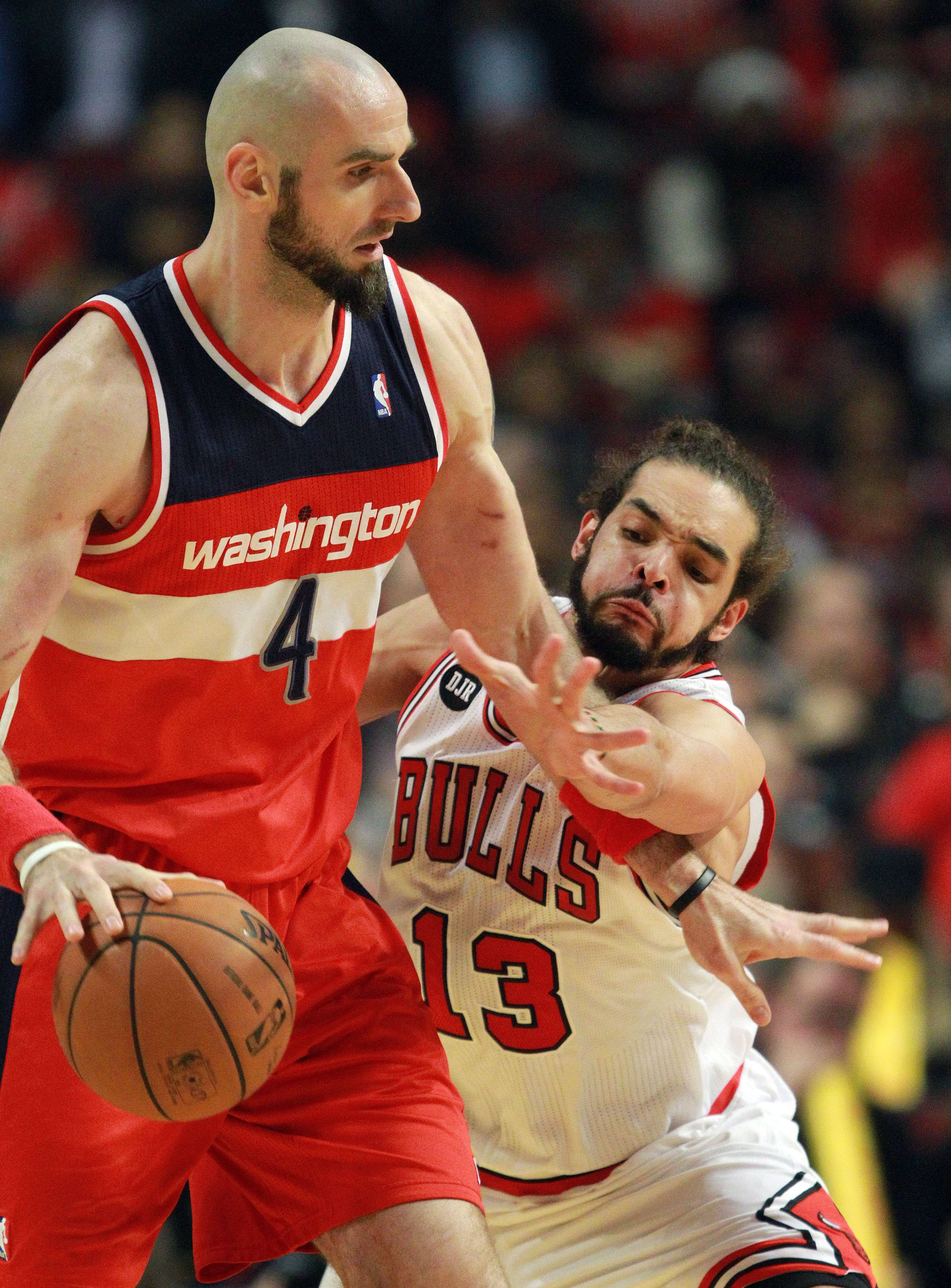Chicago Bulls center Joakim Noah tries to strip the ball from Washington Wizards center Marcin Gortat during the Bulls 75-69 loss in game five of first-round of the NBA playoffs Tuesday night at the United Center.