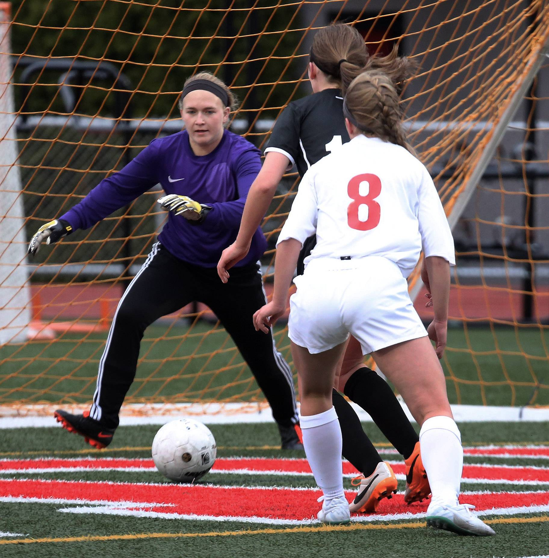 Libertyville goalie Krista Erlandson comes out to block a shot at Mundelein on Tuesday.