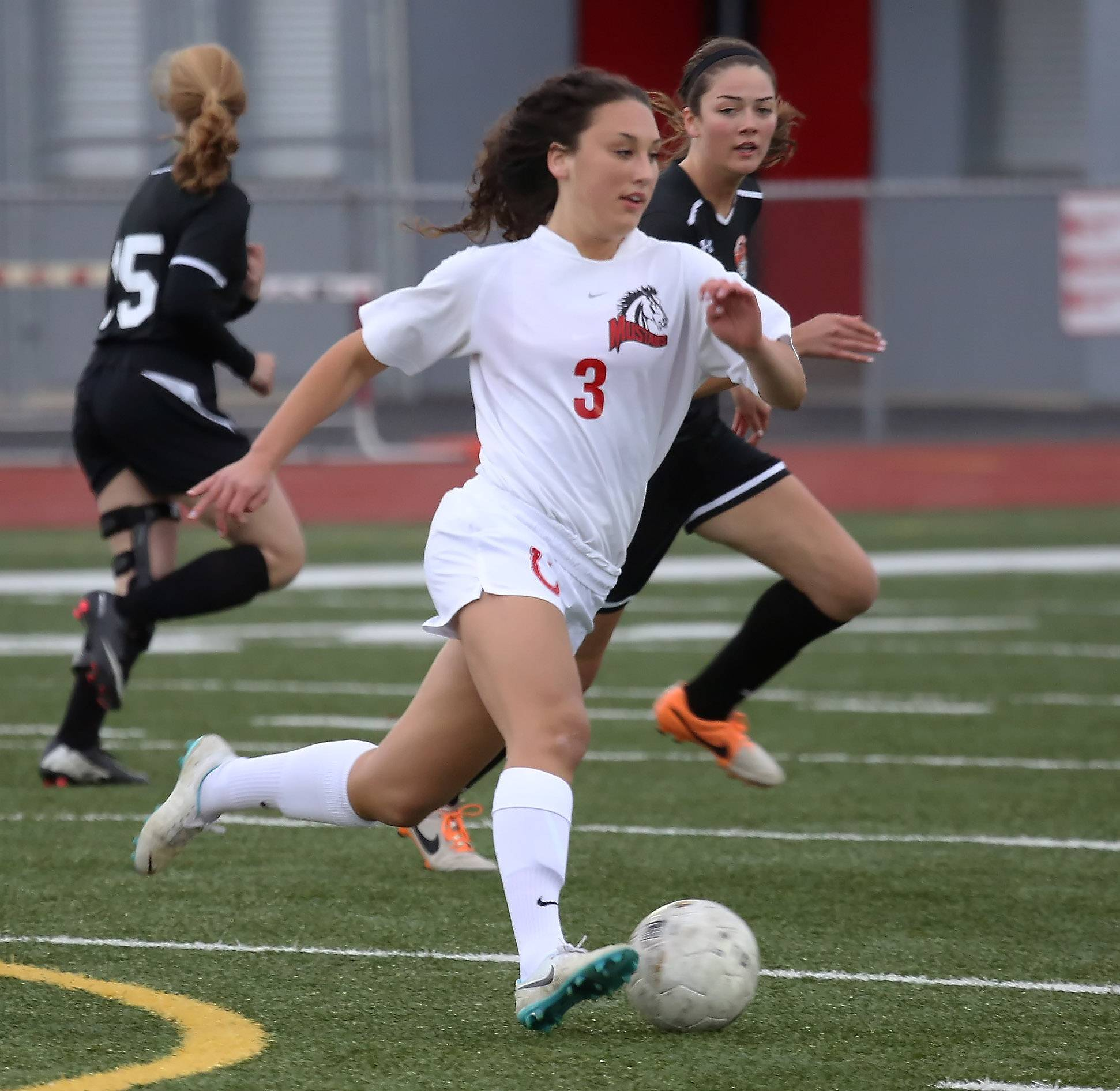 Mundelein midfielder Michele Chernesky races down the field against Libertyville on Tuesday at Mundelein.