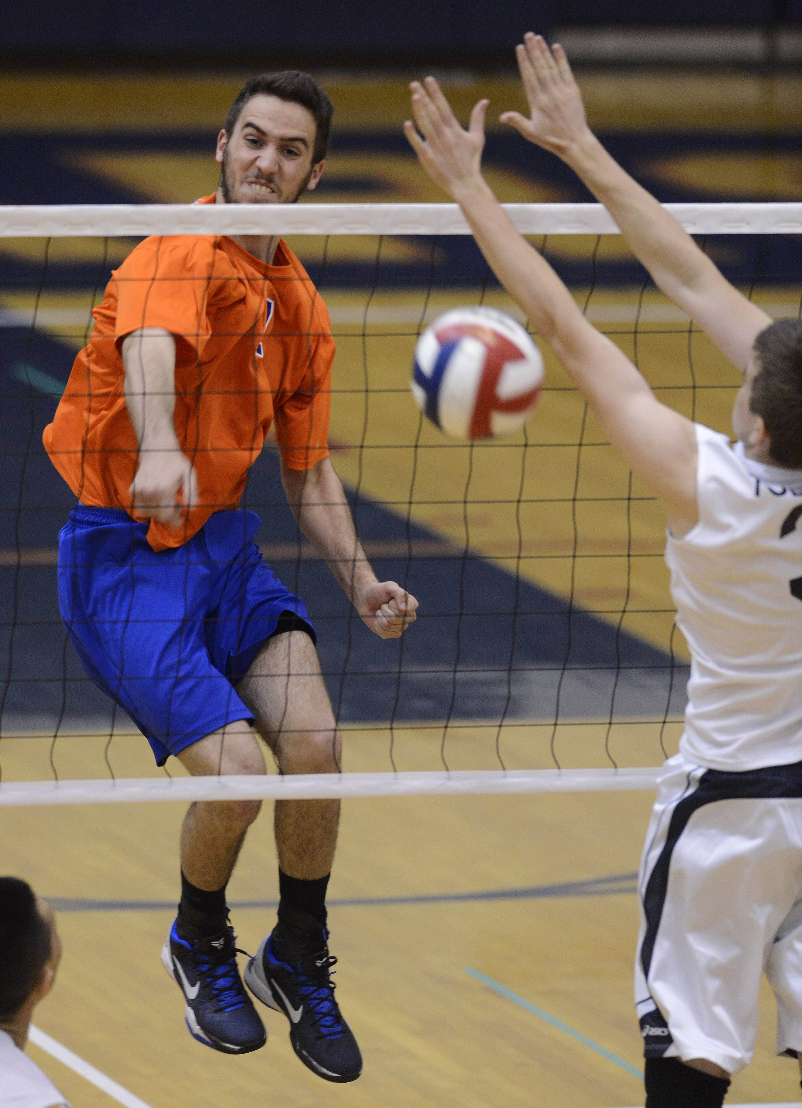 Hoffman Estates' Connor Rodheim, left, looks for a kill past the out-stretched hands of Conant's Nikola Todorov during Tuesday's match.