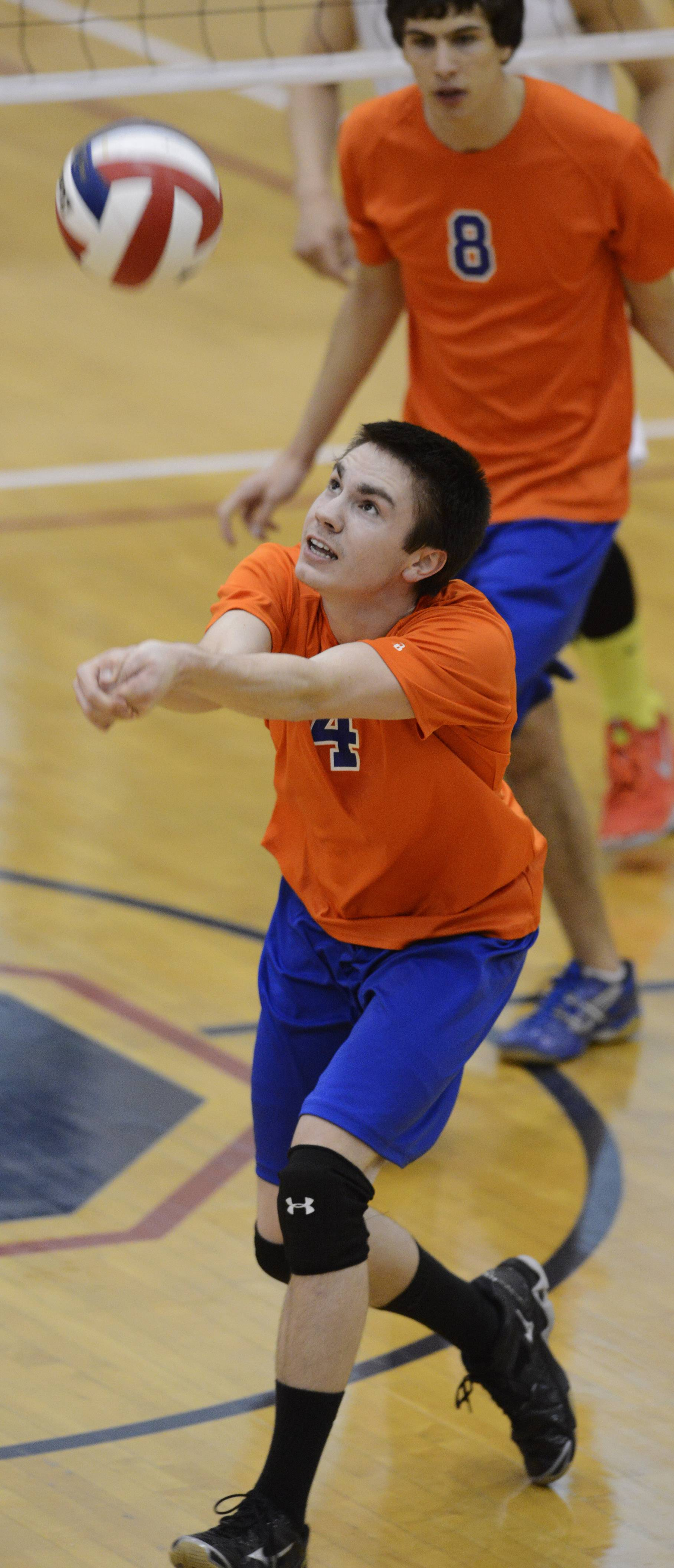 Hoffman Estates' Matt Stacy looks for a dig during Tuesday's match with Conant.